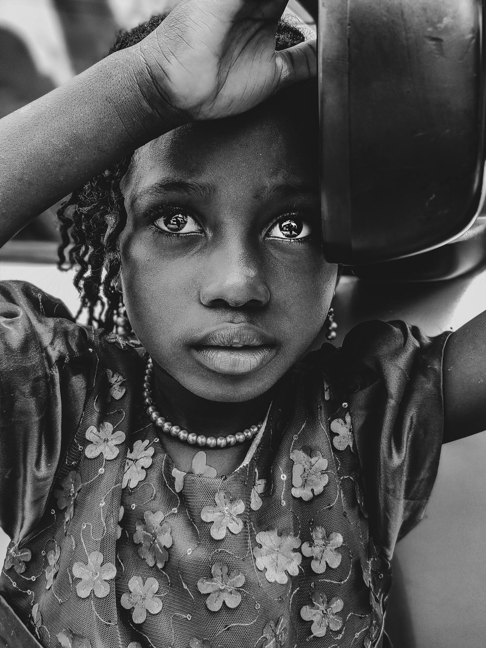 girl holding bowl on grayscale photography