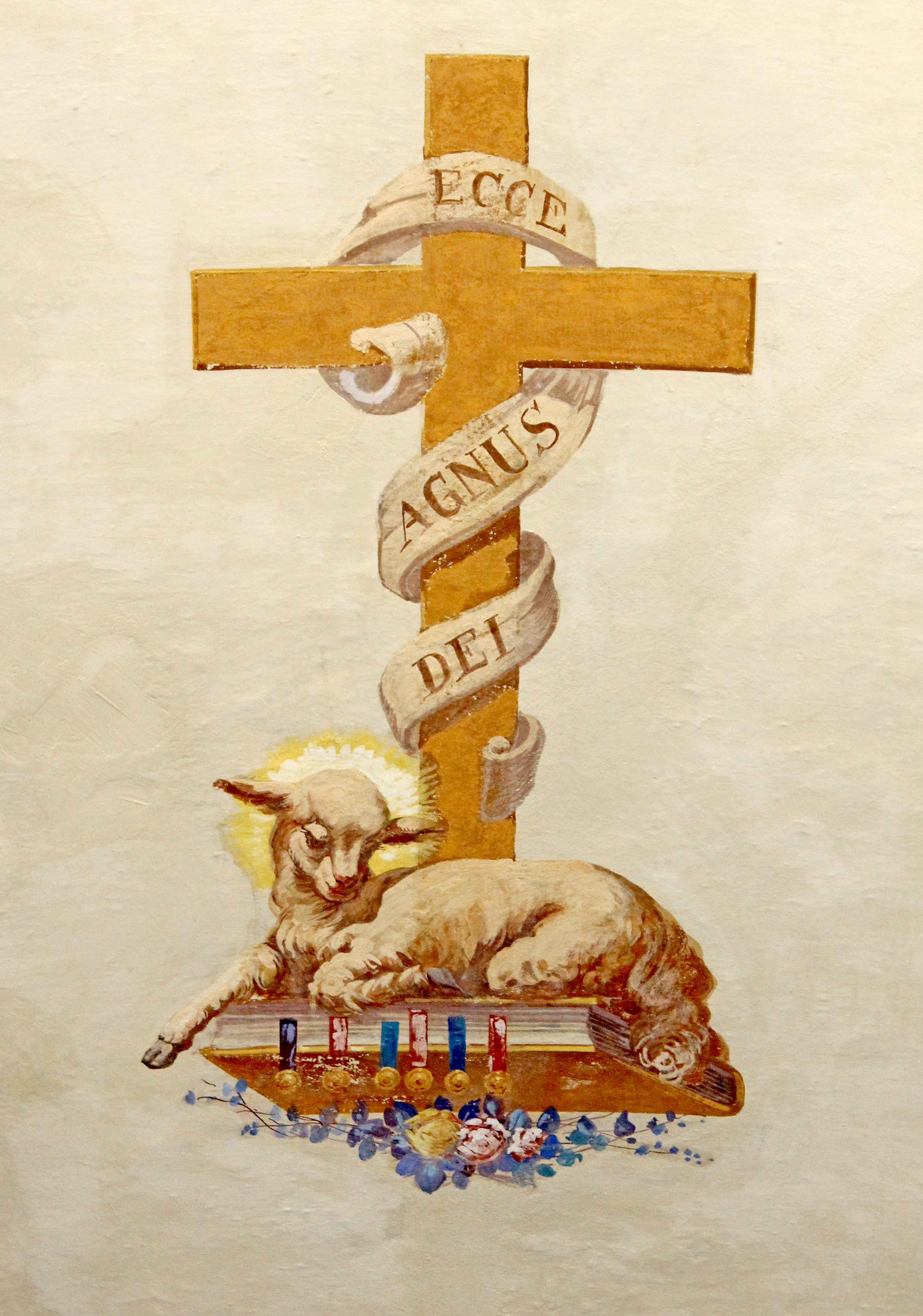 lamb on bible under cross illustration