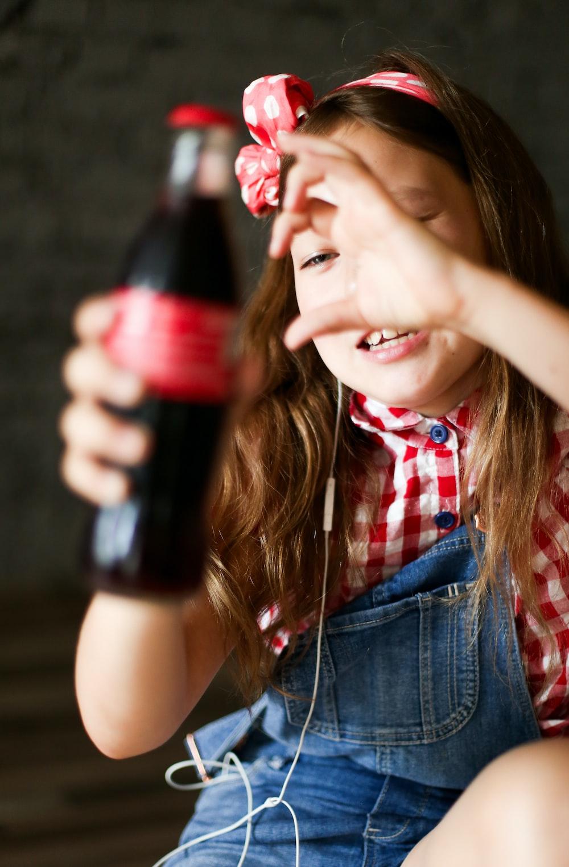 smiling girl holding bottle