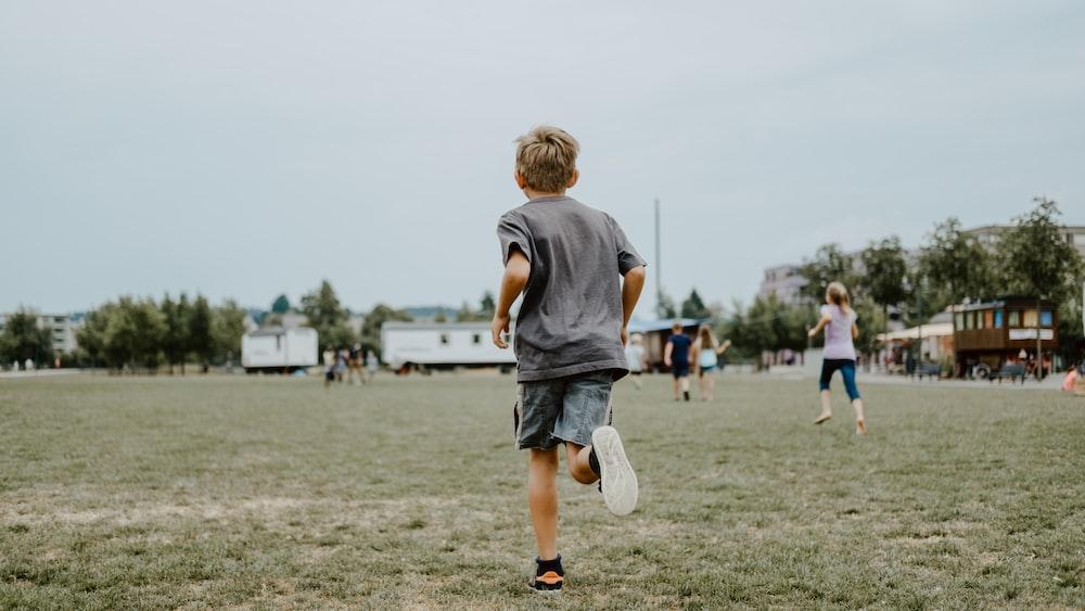 boy running on lawn