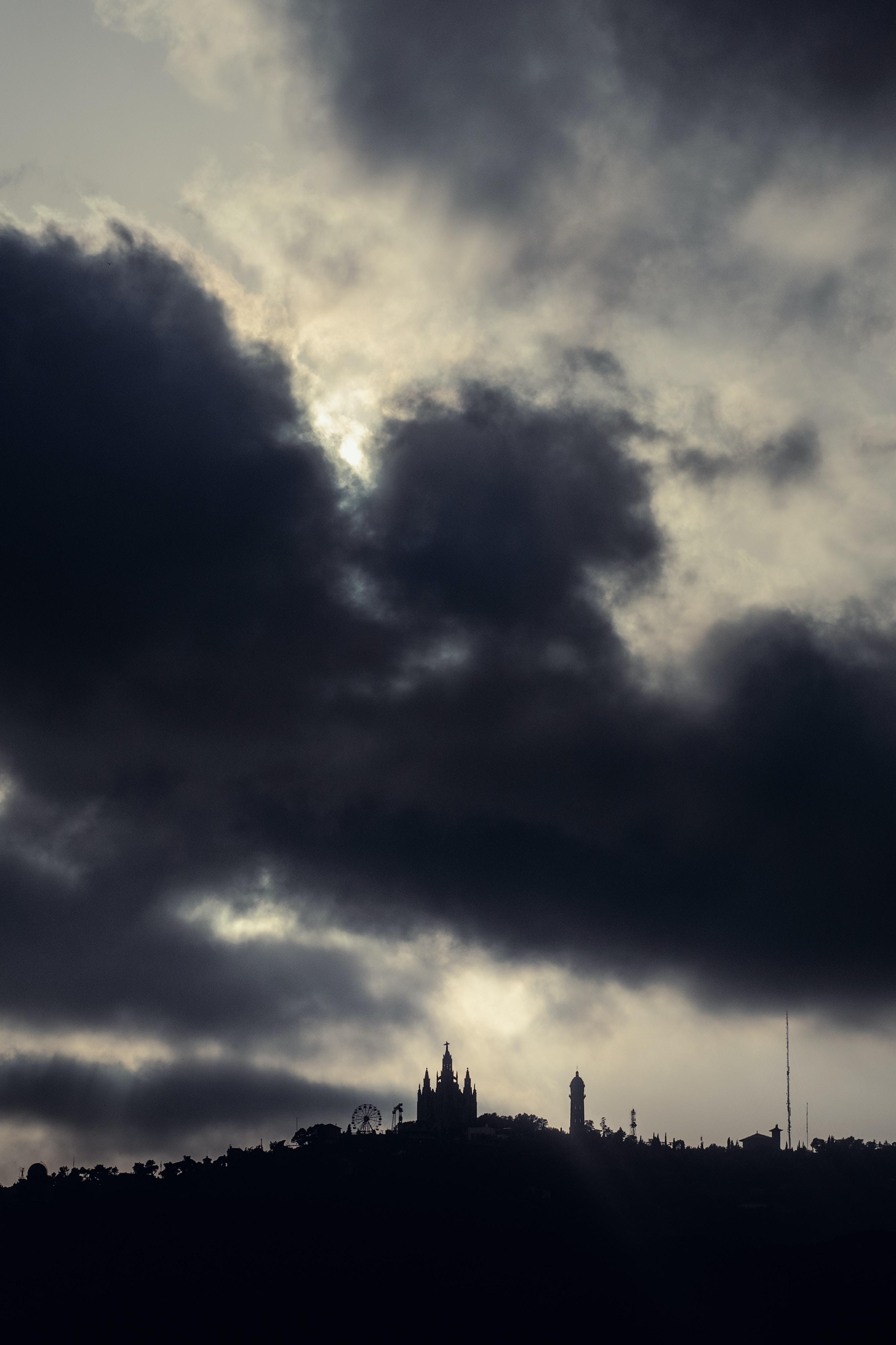 silhouette of buildings under gray sky