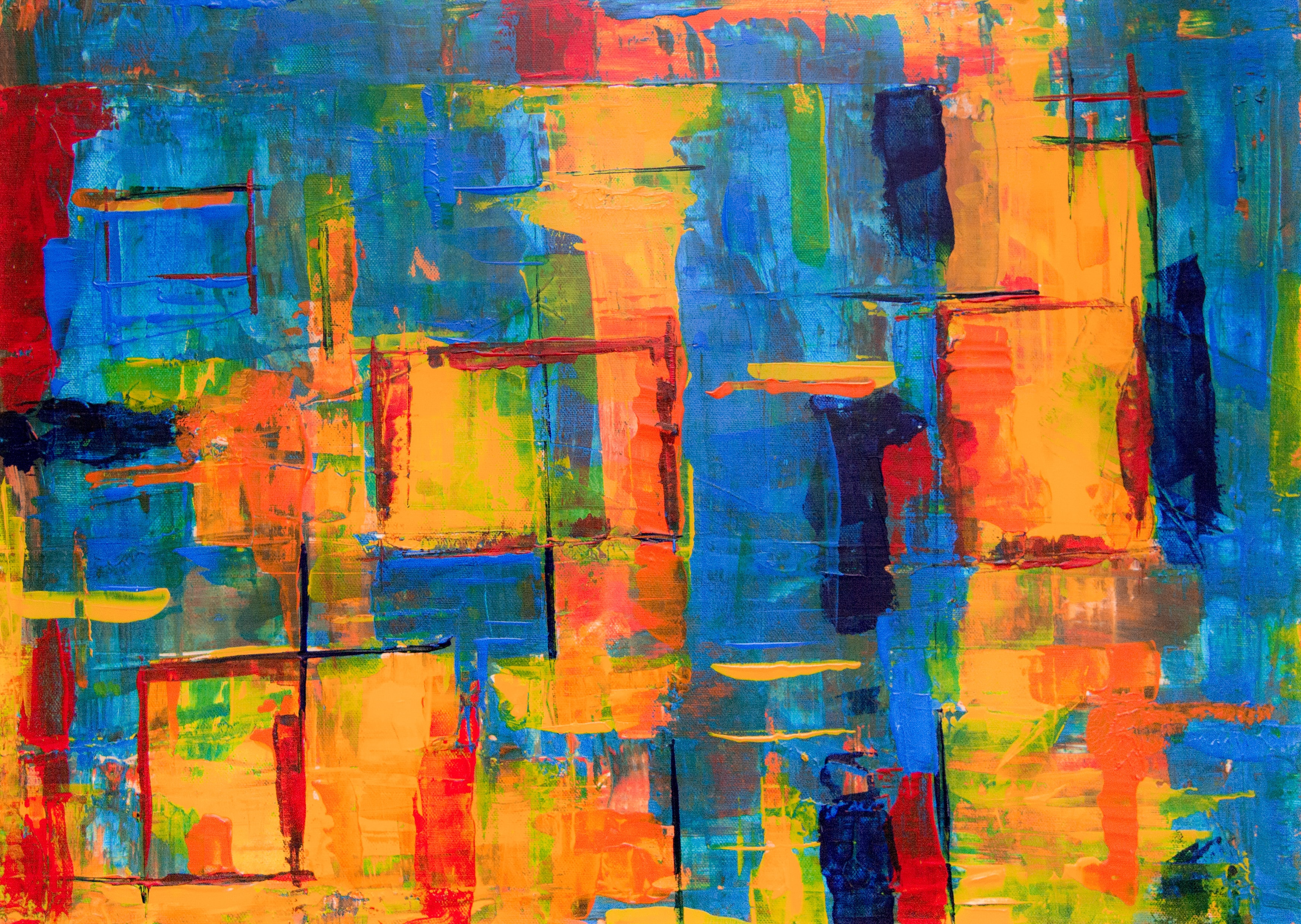 close-up photo of yellow and blue abstract painting