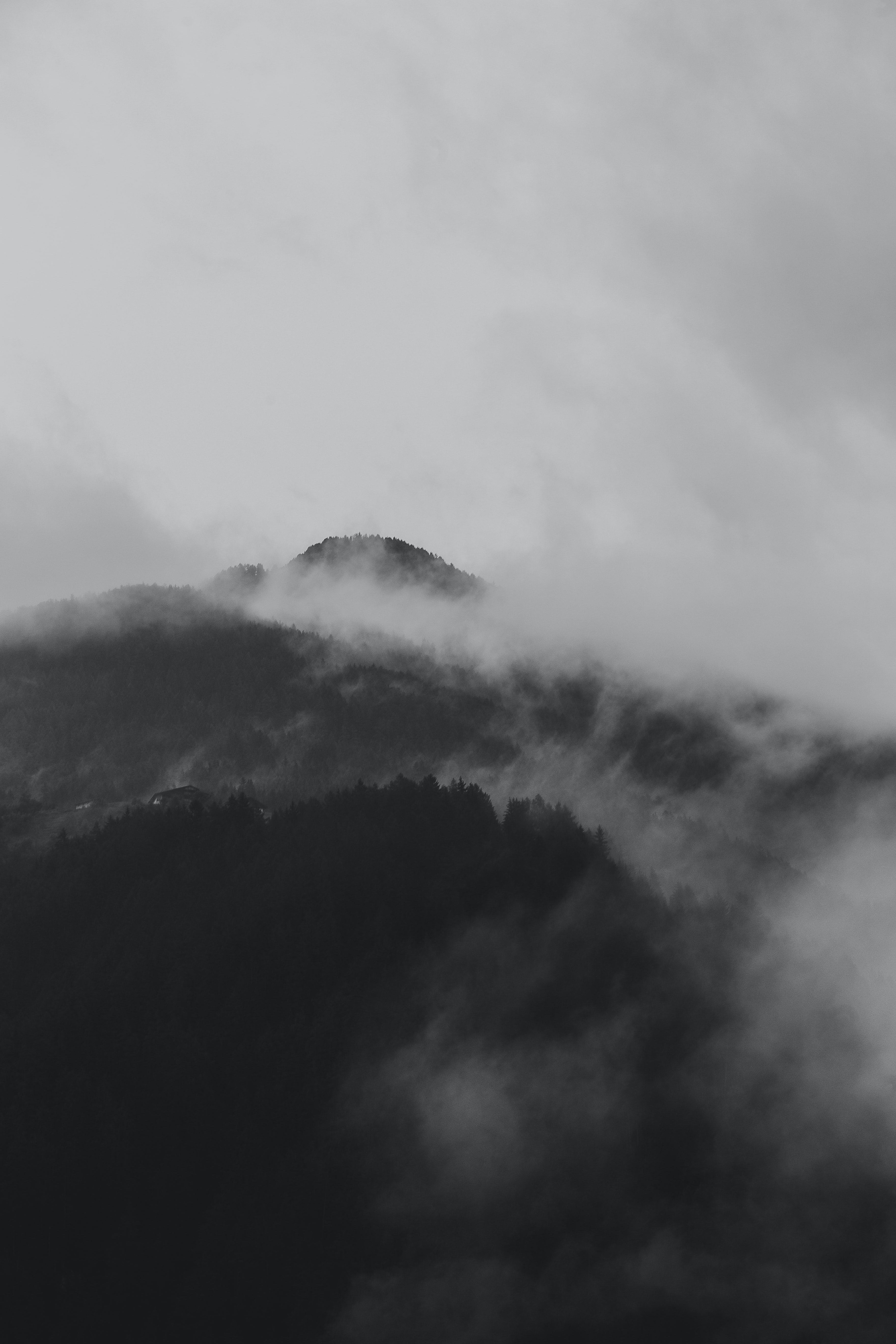 grayscale photo of mountain with clouds