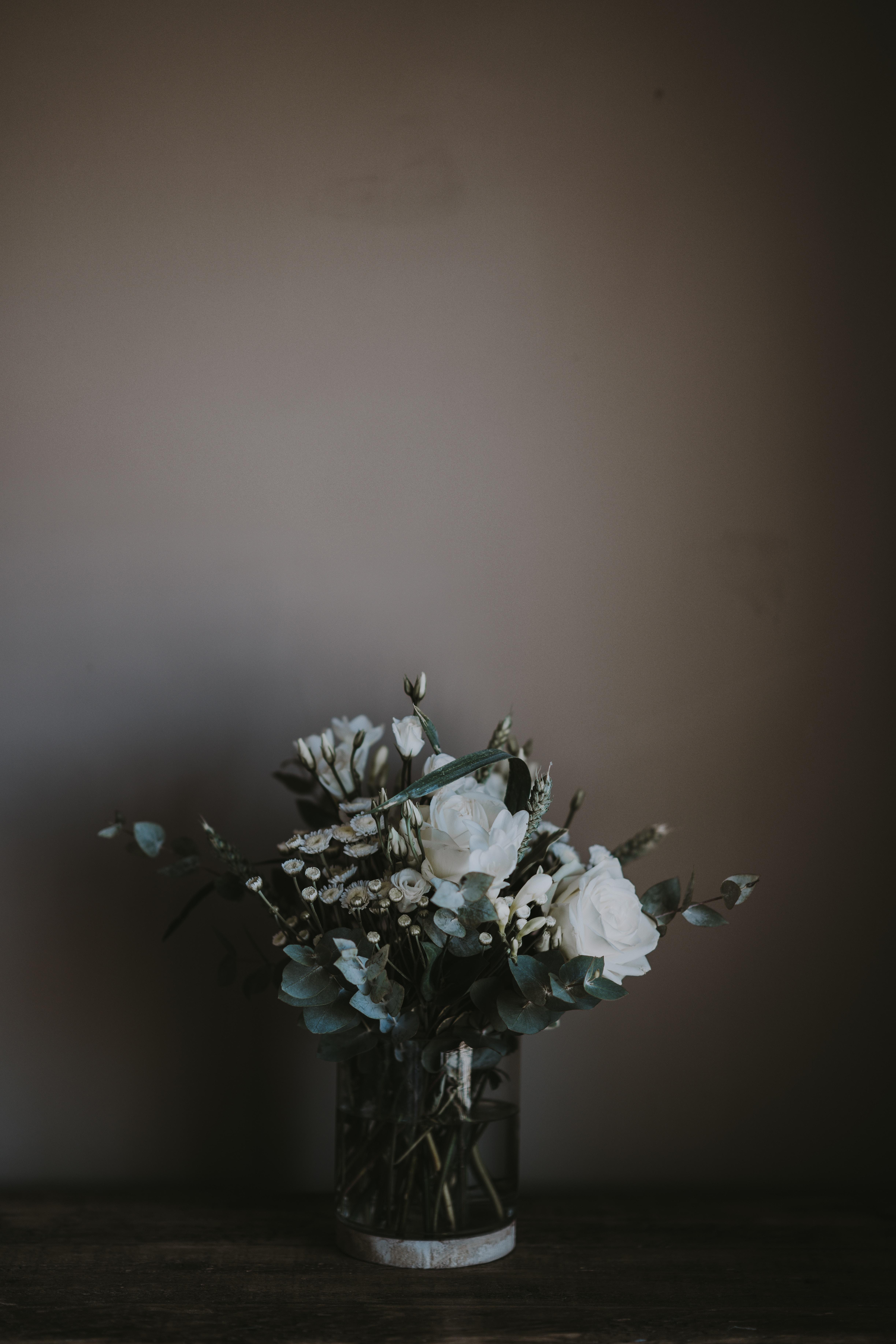 white petaled flower vase