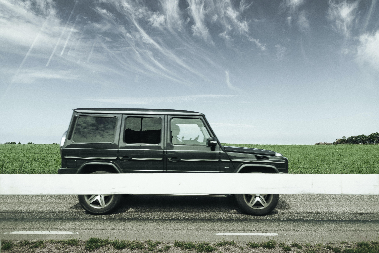 black SUV near green grass outdoors