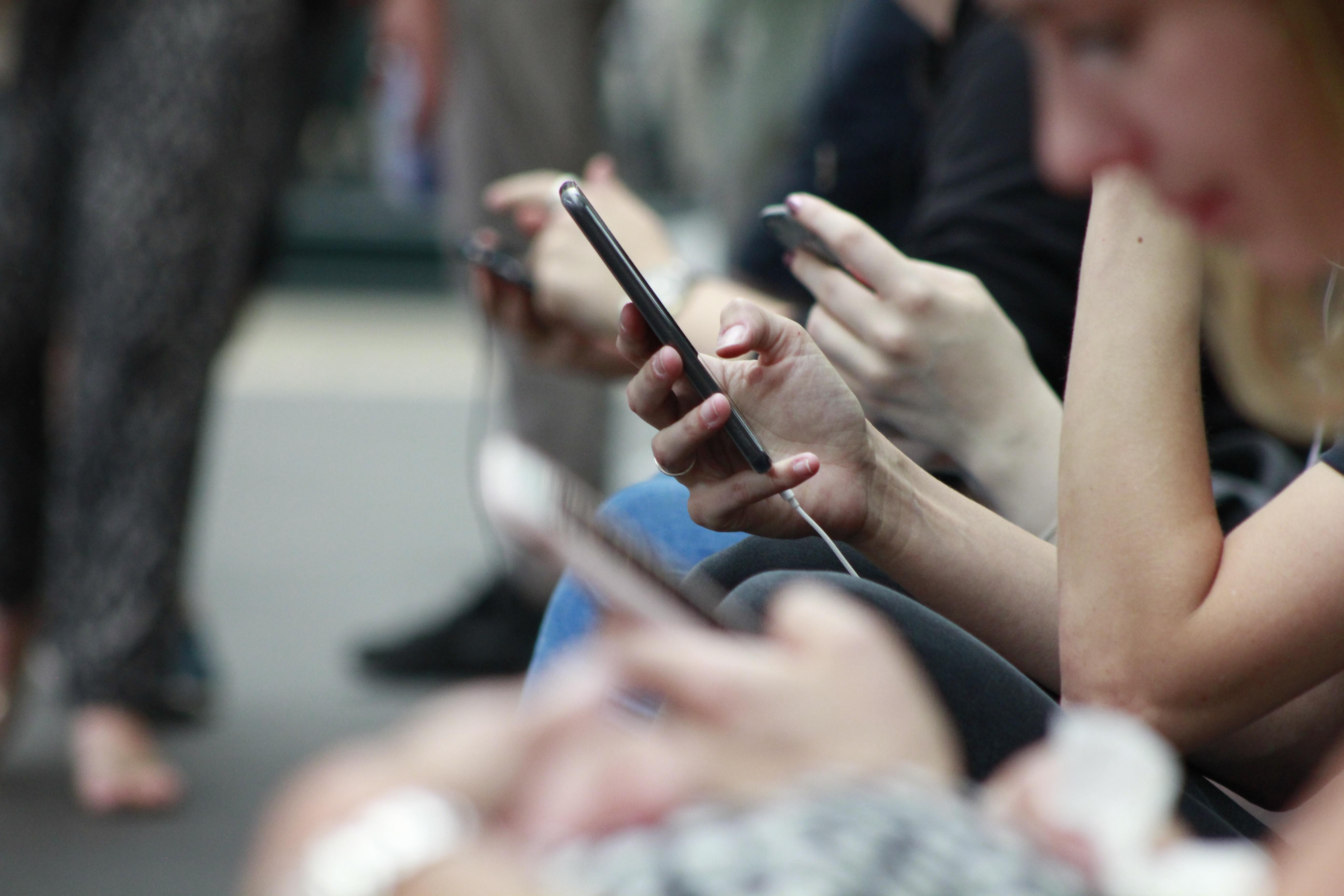 People Glued to Phones