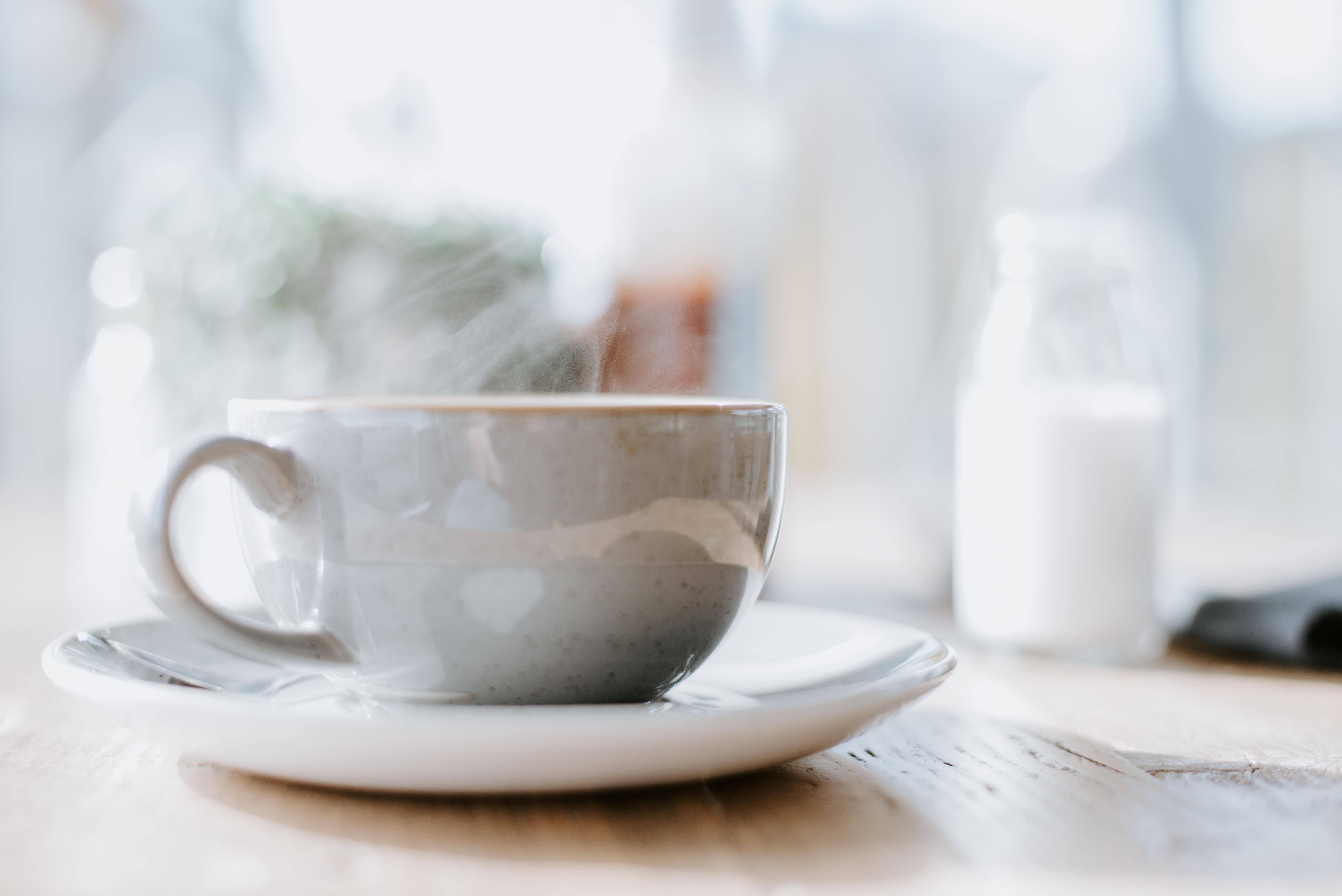 white ceramic teacup on round white saucer