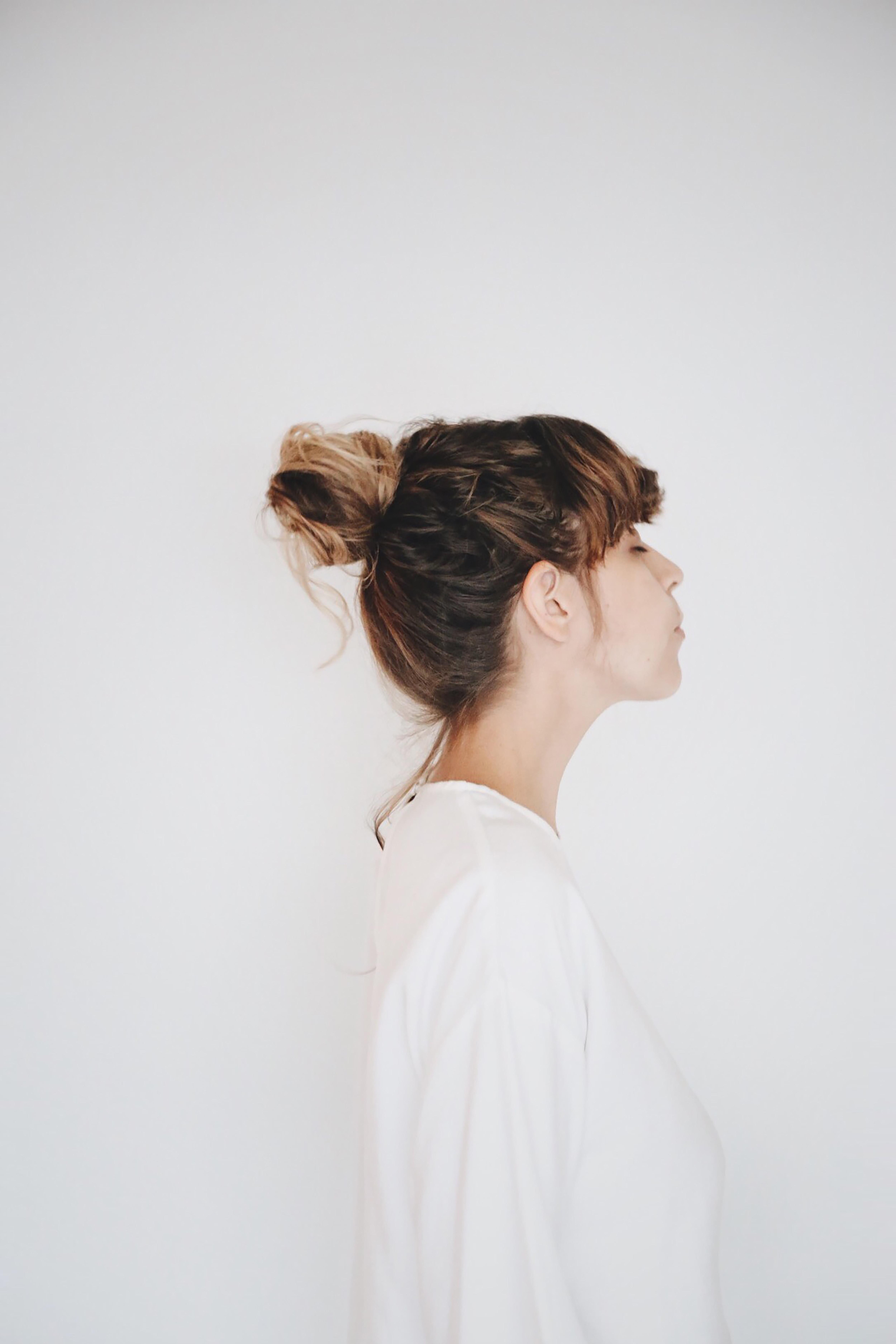 woman beside white wall
