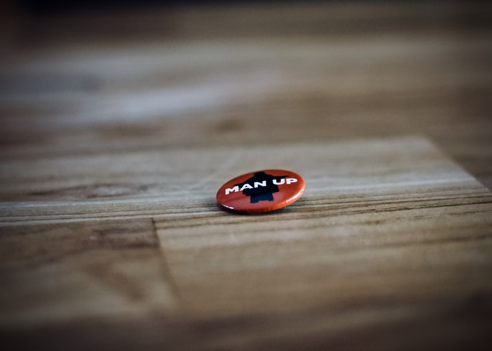 round red and black man up pin back button