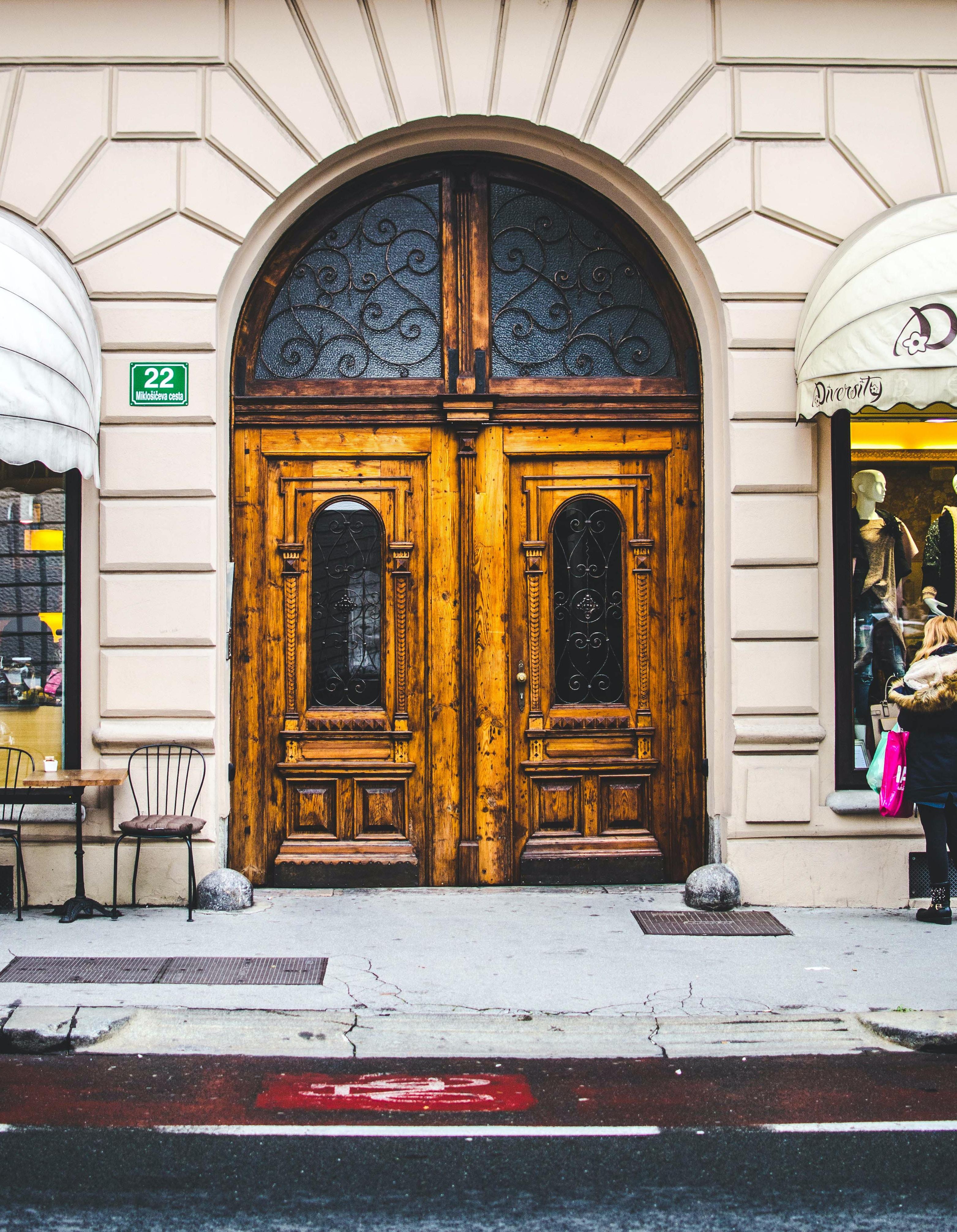 brown wooden door of boutique