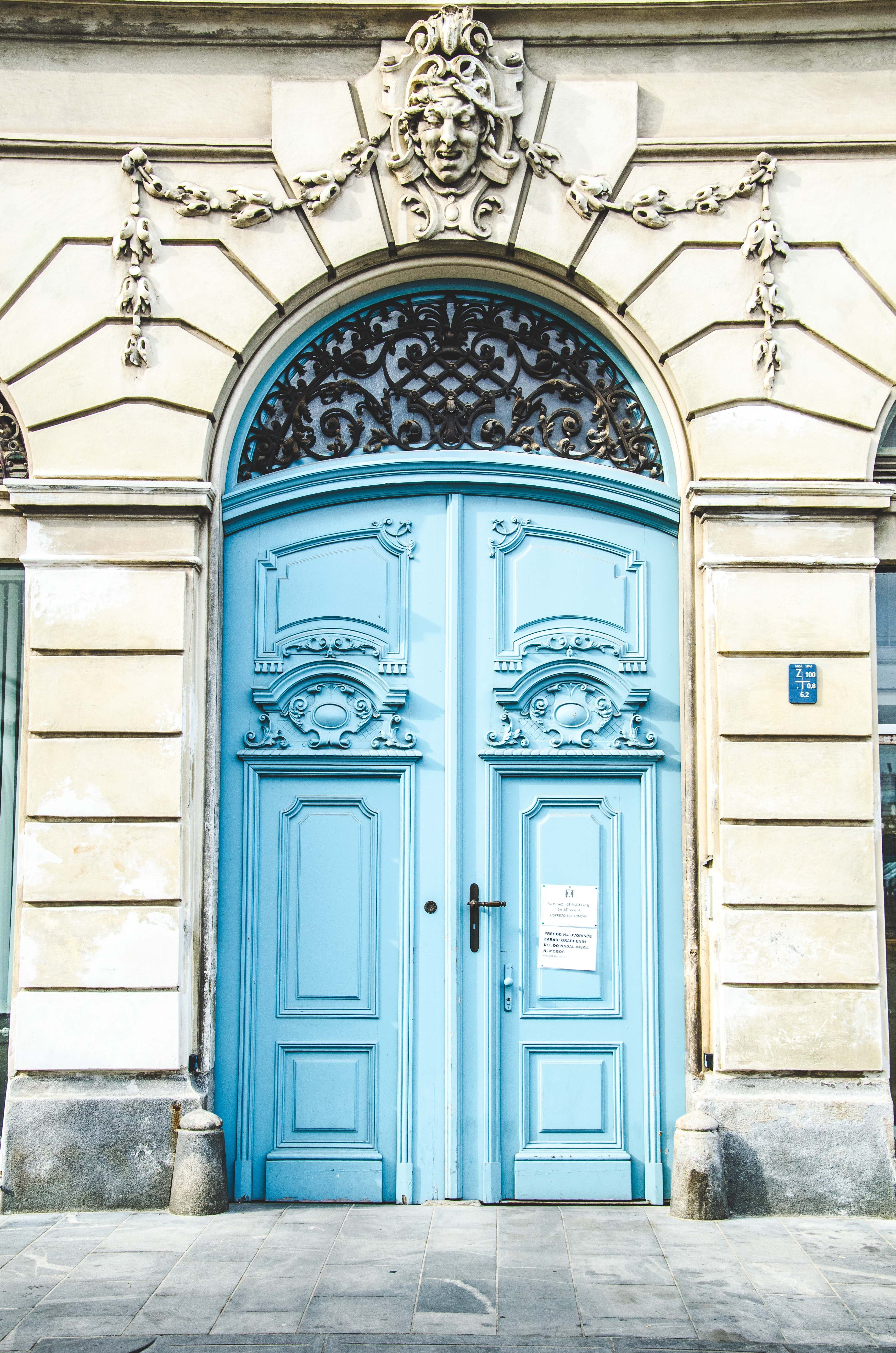 white building with blue wooden doors