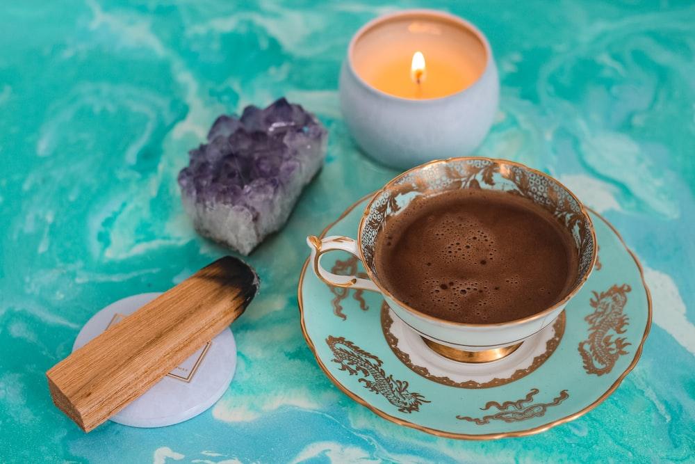 mug with brown coffee inside