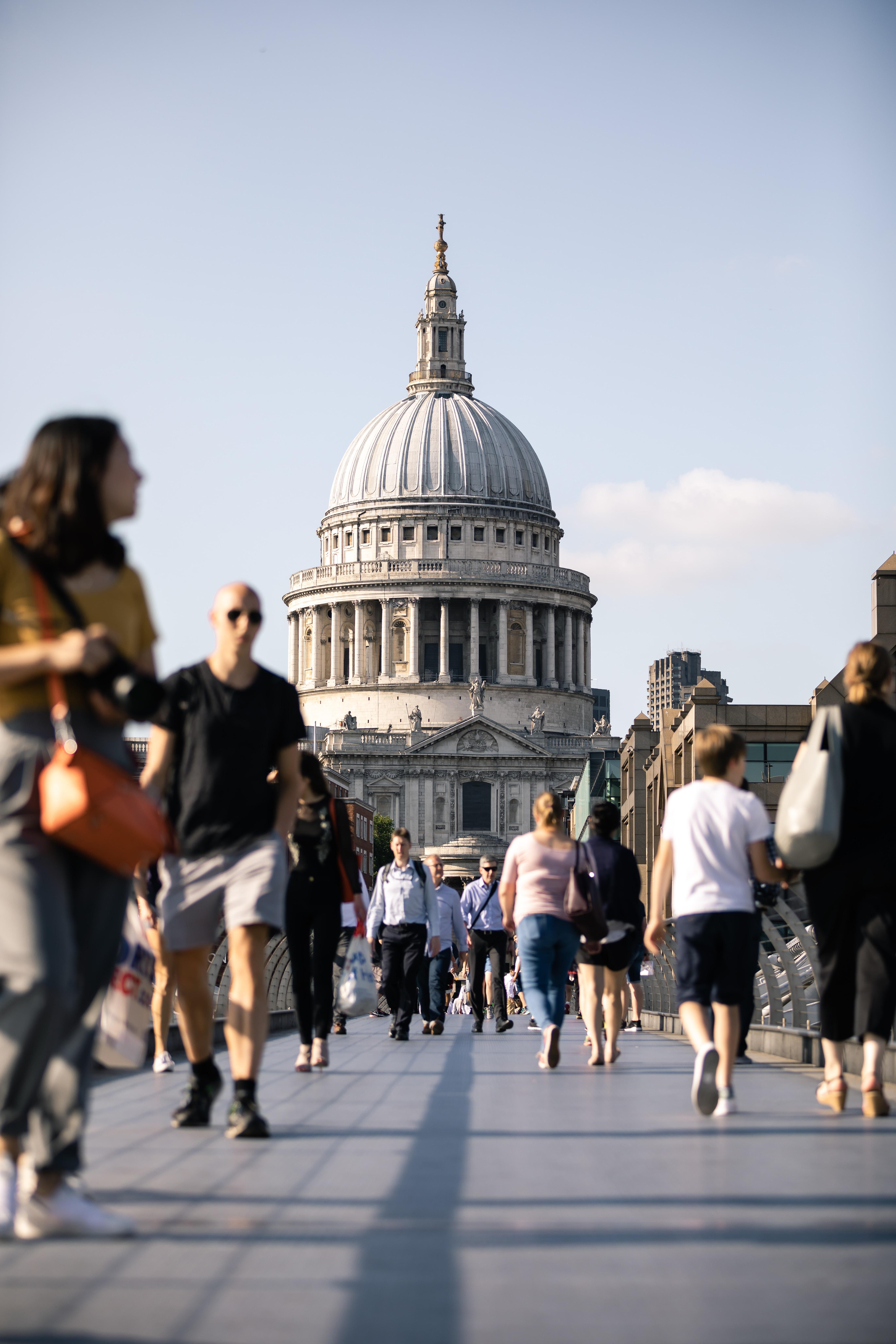 people walking on bridge