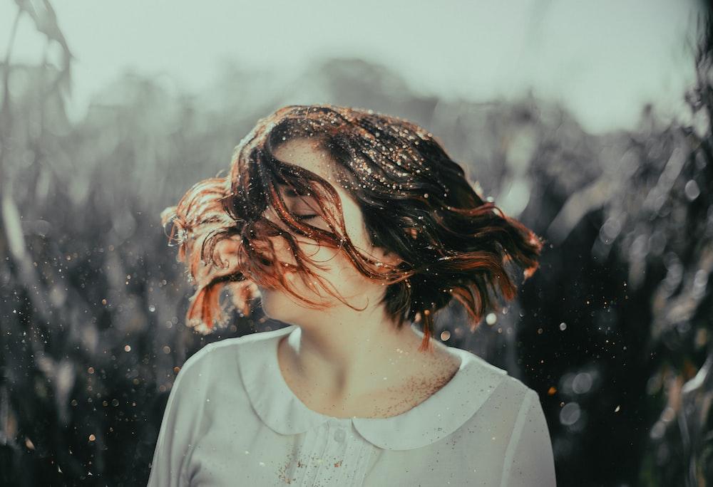 woman wearing white scoop-neck collared sh irt
