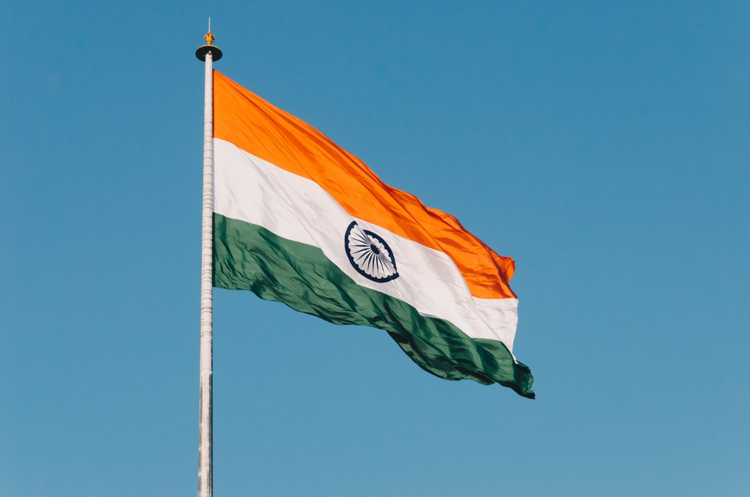 The Indian tricolour flag waving in the wind at the Wagah border near Amritsar in Punjab, India.