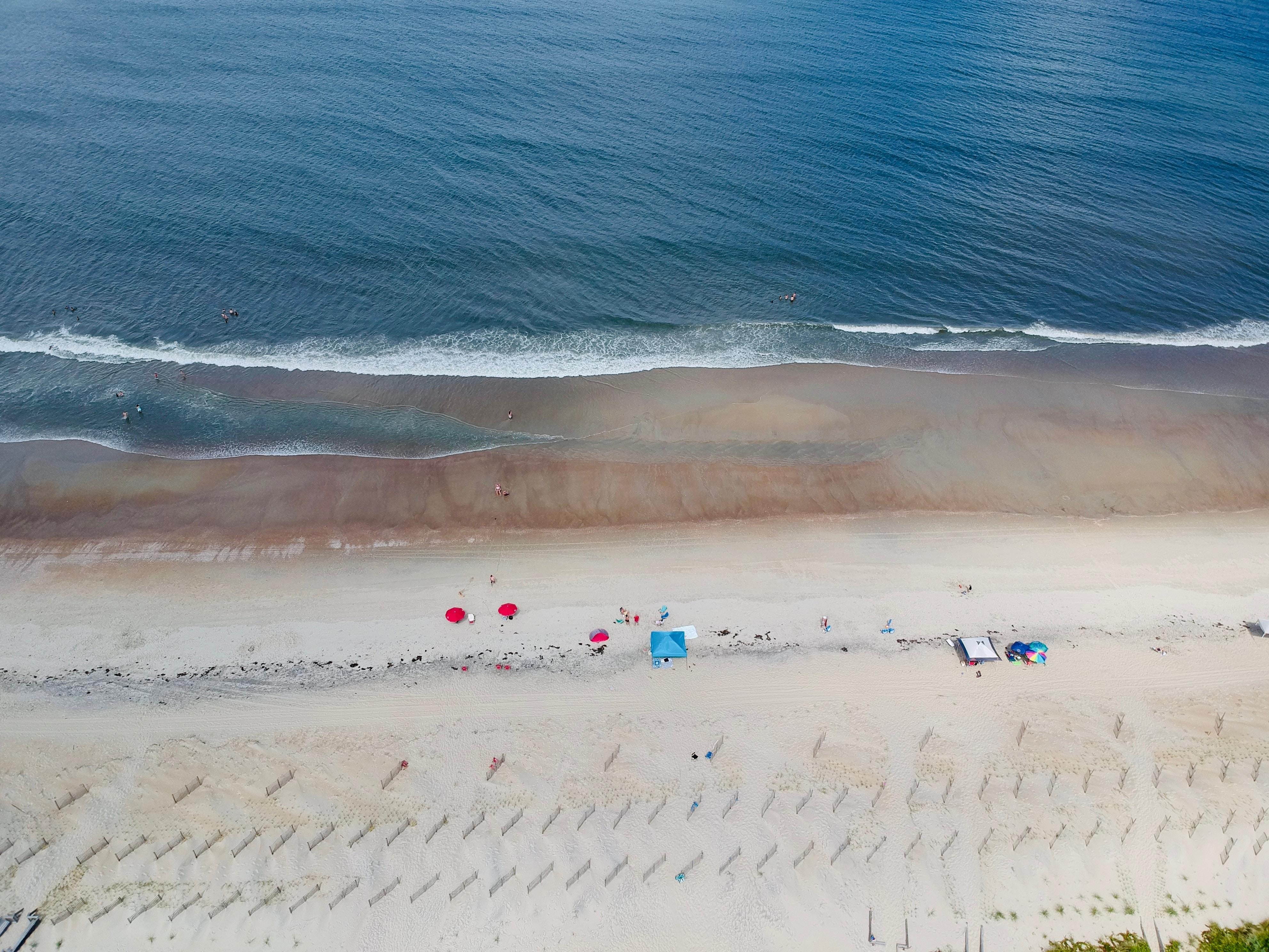 red beach umbrellas on beach