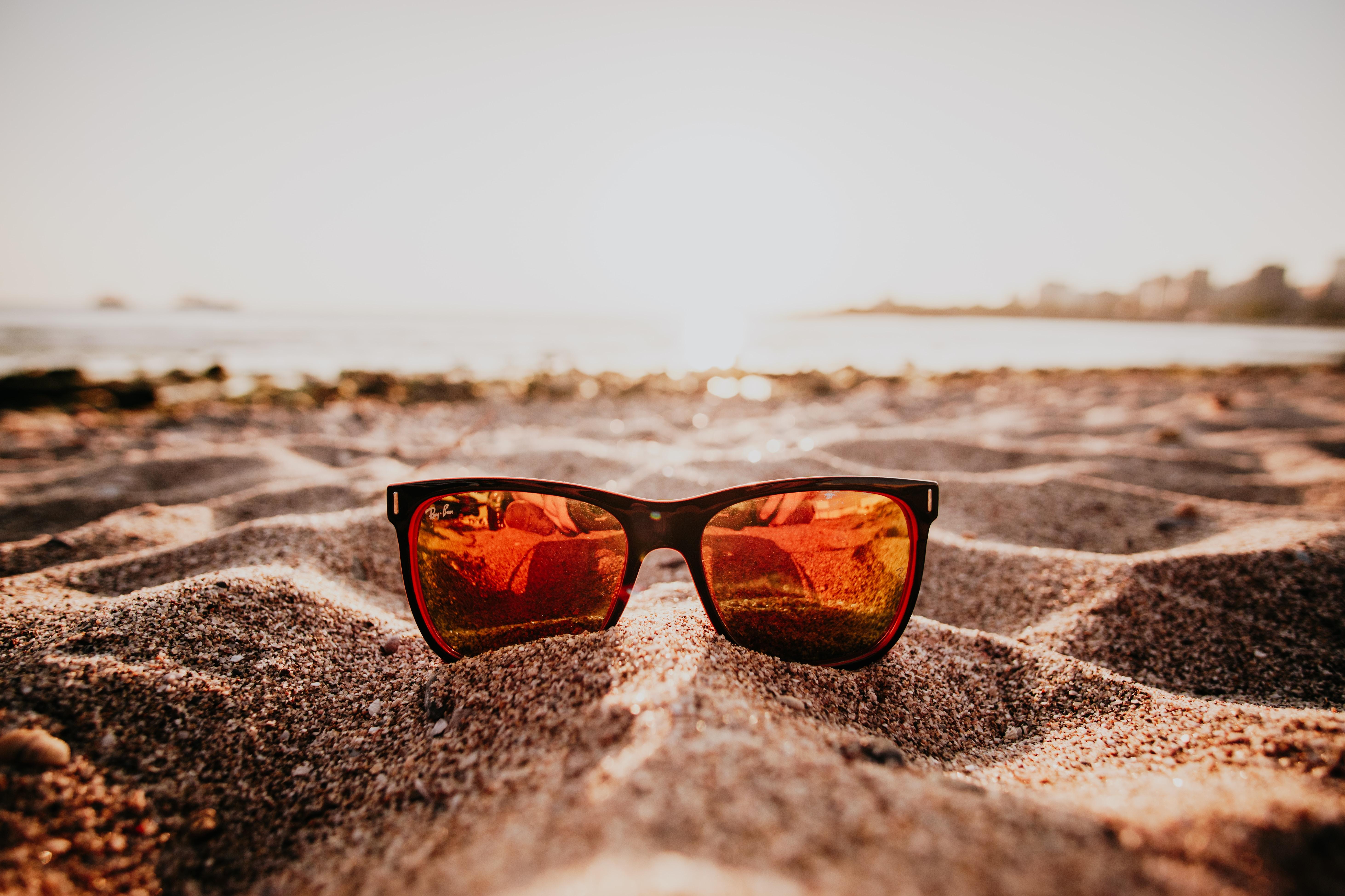 sunglasses on sand