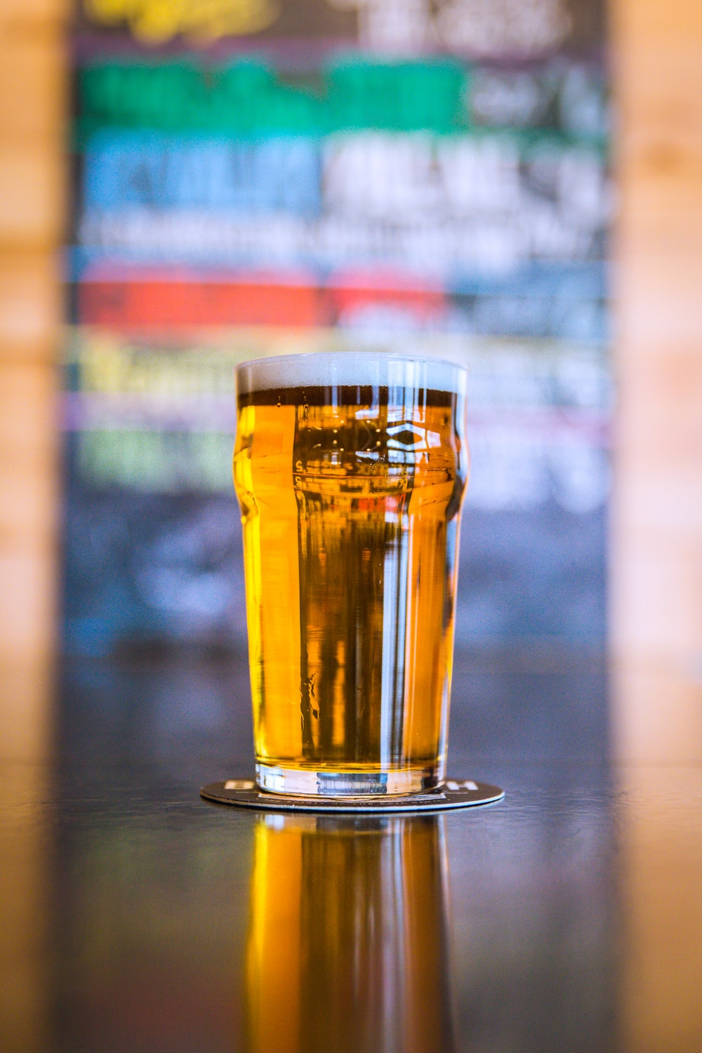 shallow focus photography of clear beer glass