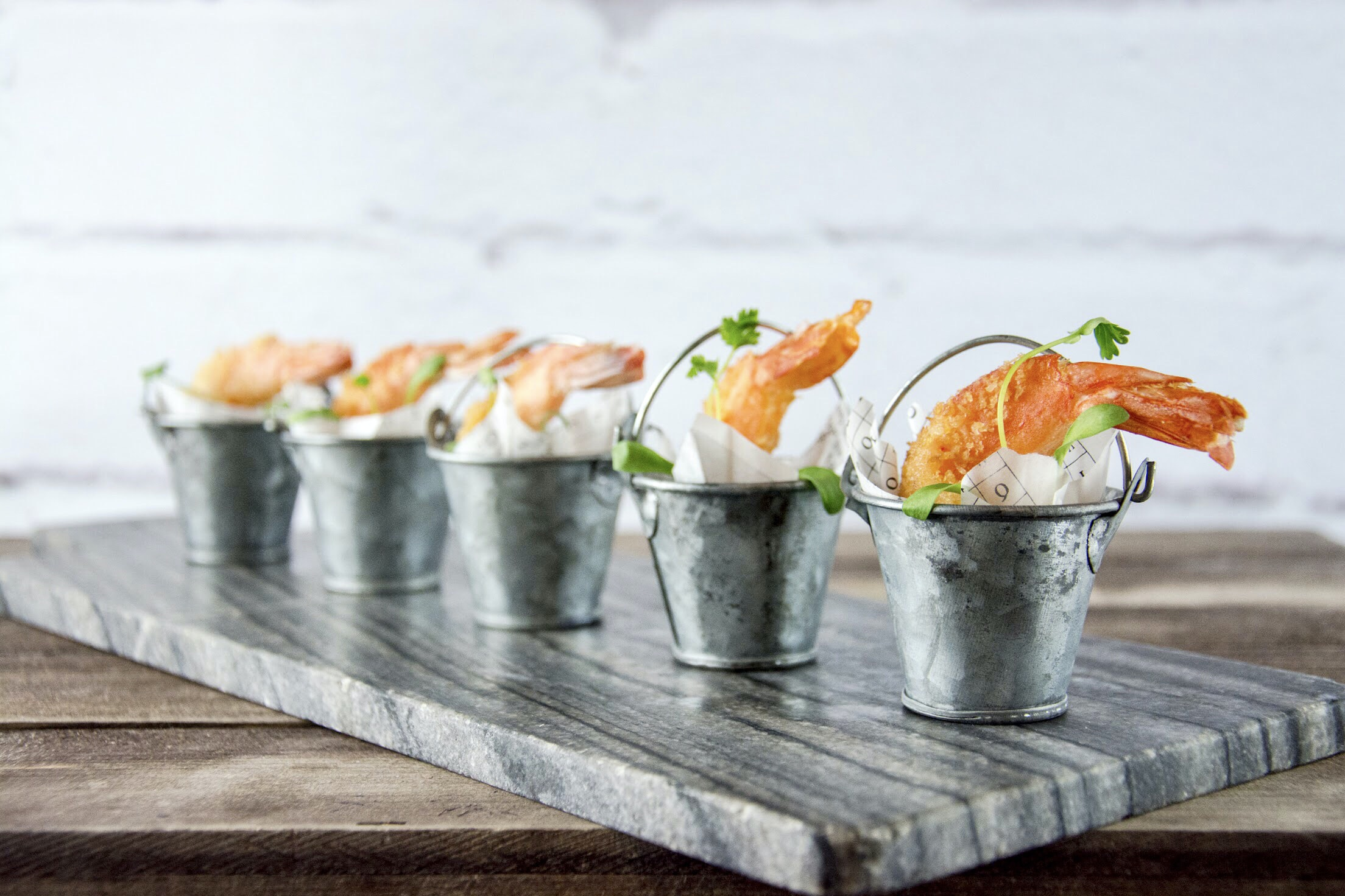 five steel buckets with tempura