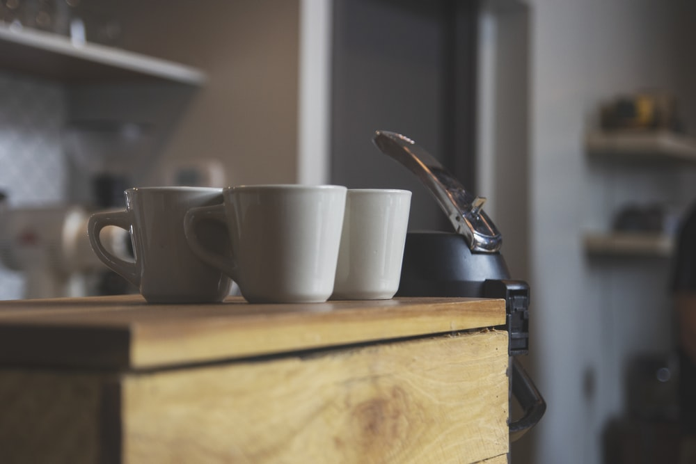 three white ceramic coffee mugs