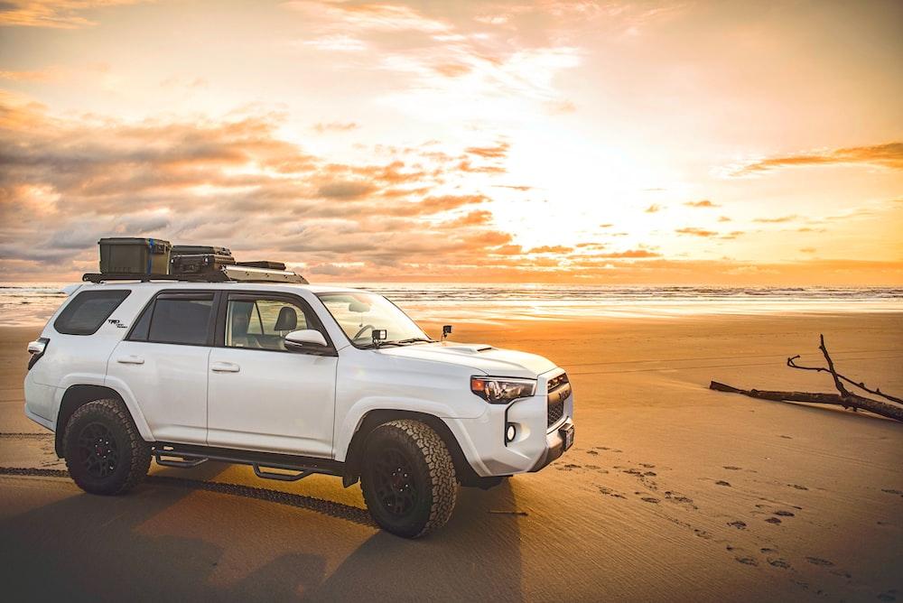 white SUV on beach