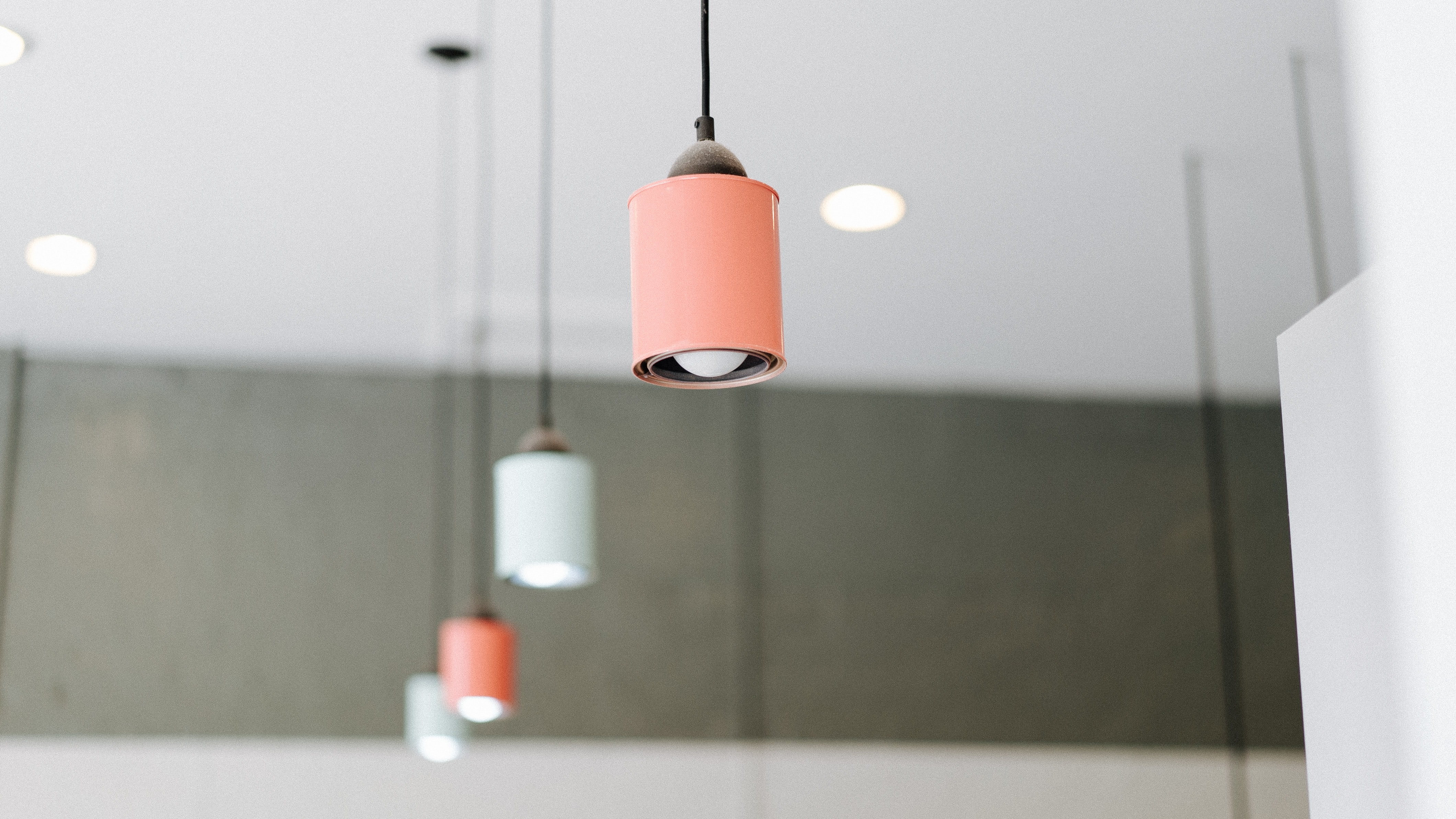orange and white pendant mounted on ceiling