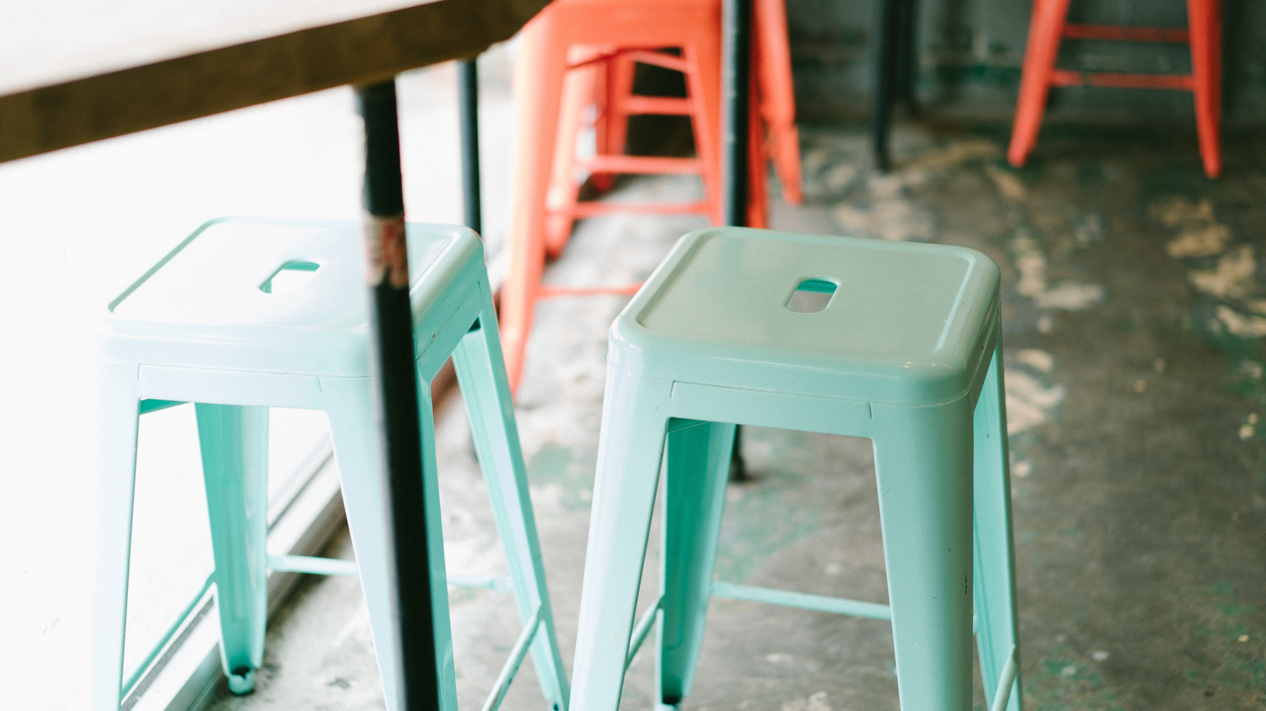 two teal plastic stools