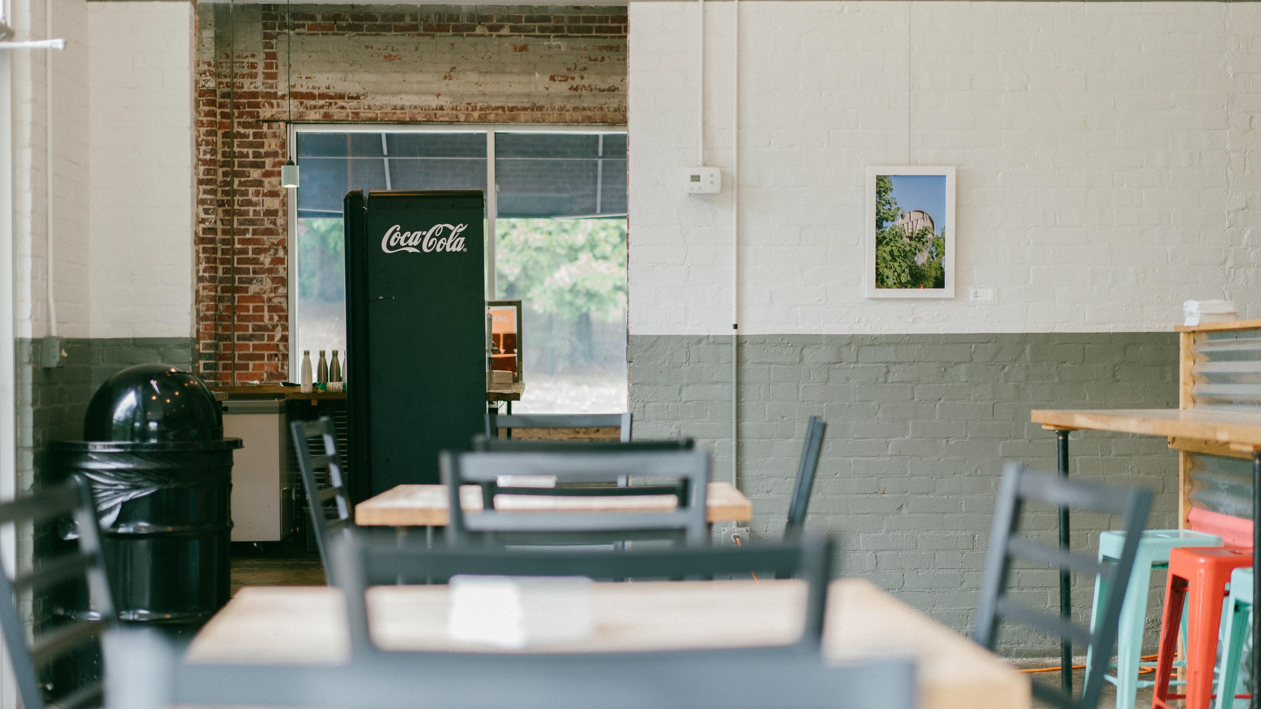depth of field photo of Coca-Cola commercial refrigerator