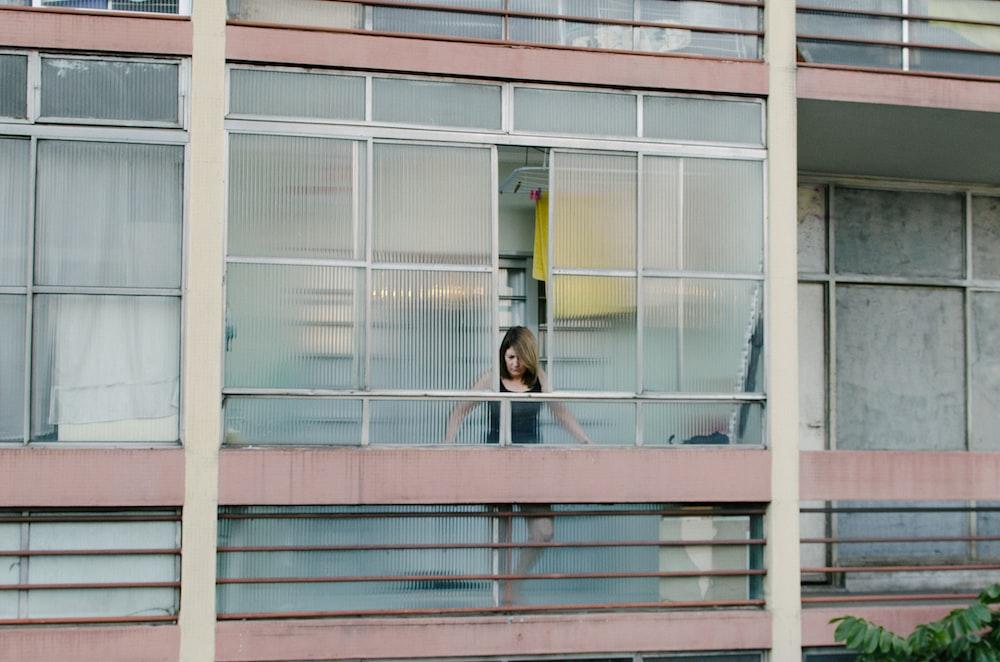 woman looking thru windows
