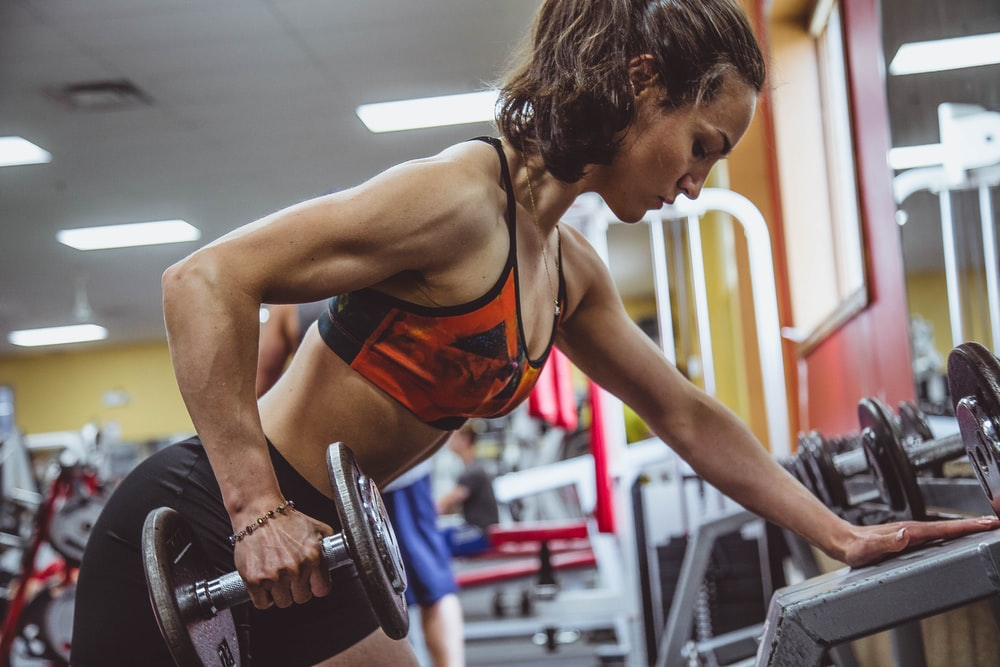woman seriously performing gym exercise