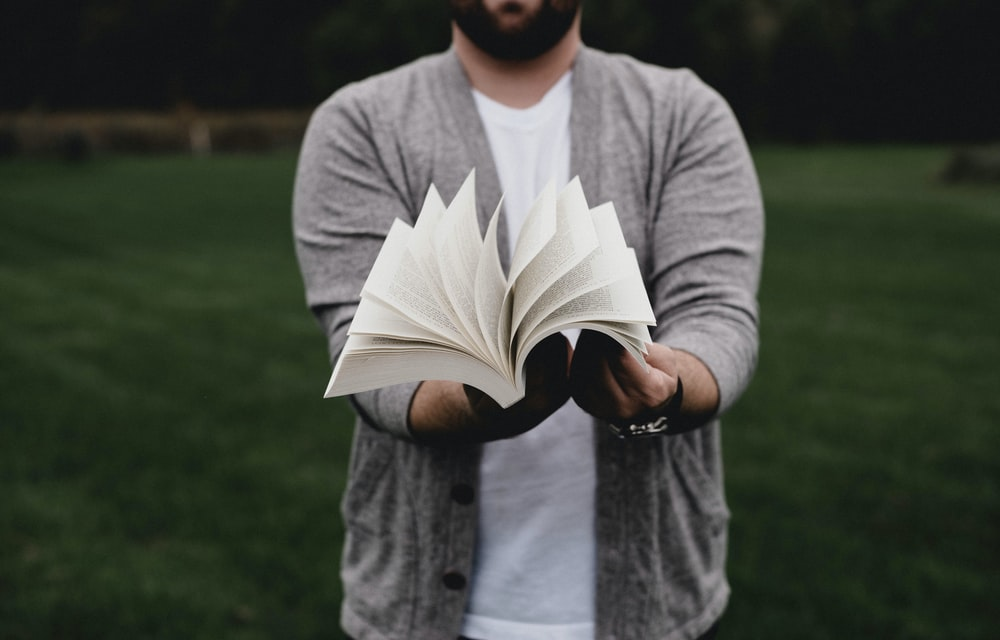 person opening book