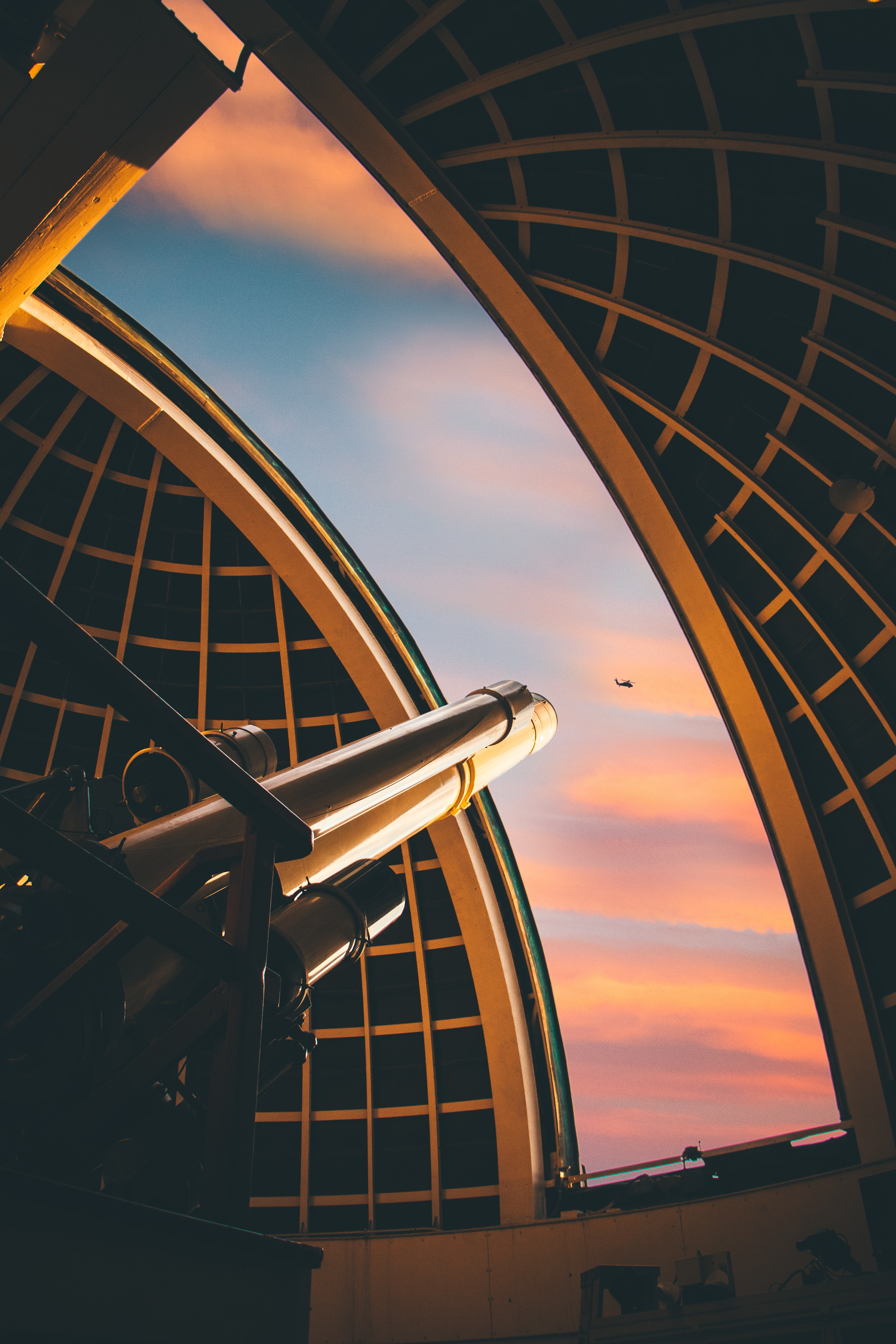 telescope pointed at helicopter on mid air