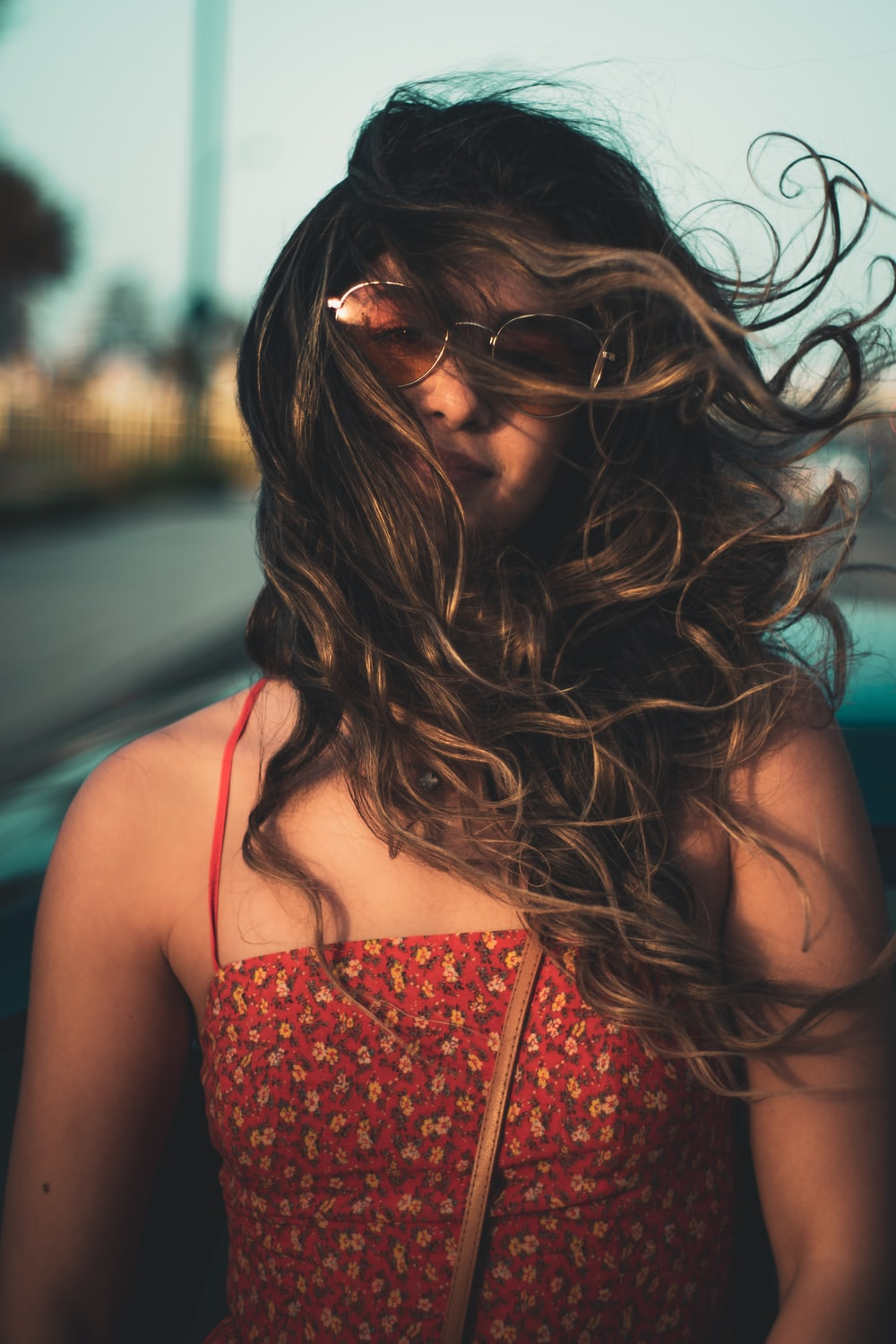smiling woman's face covered by hair