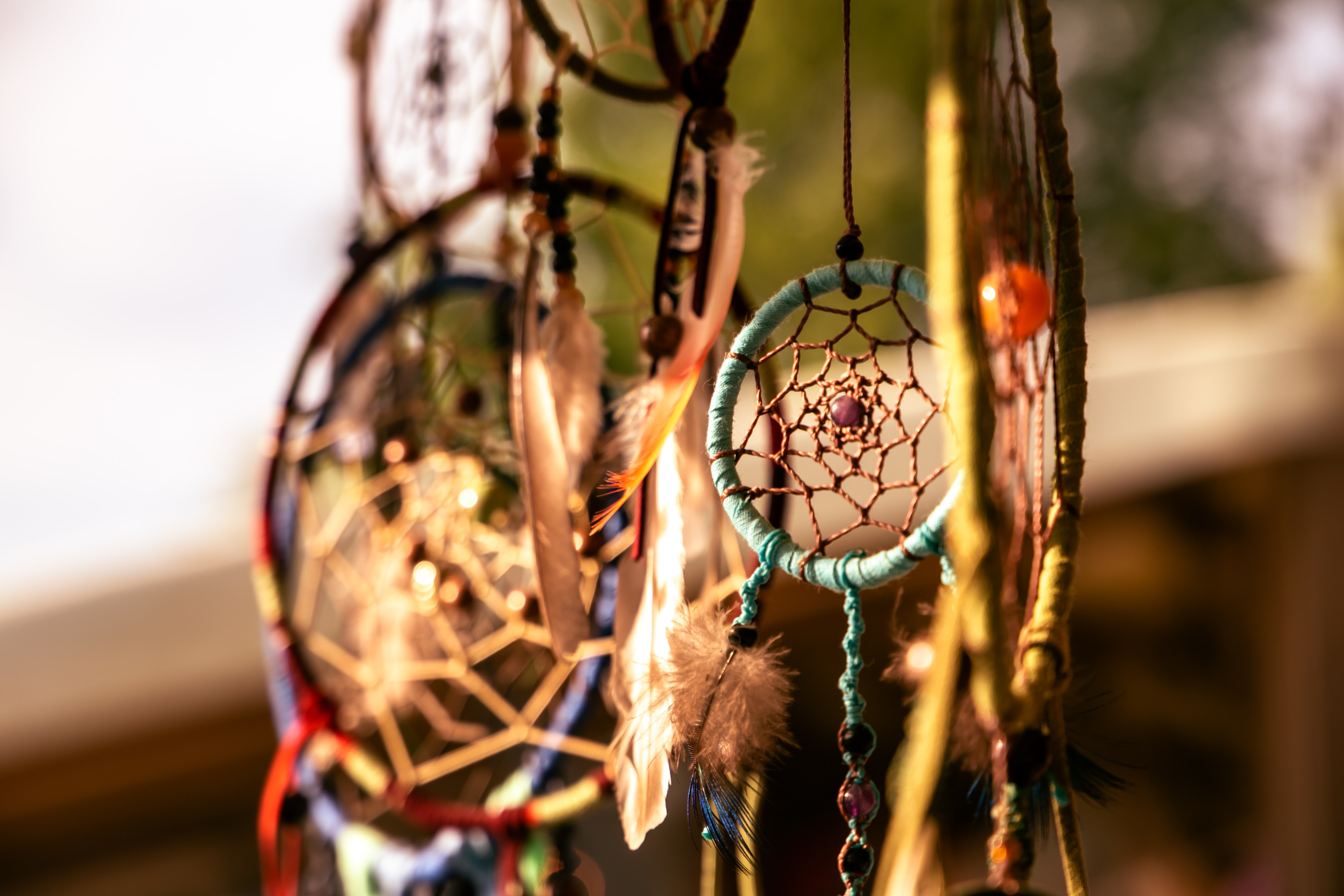 close-up photography of assorted-color dreamcatchers
