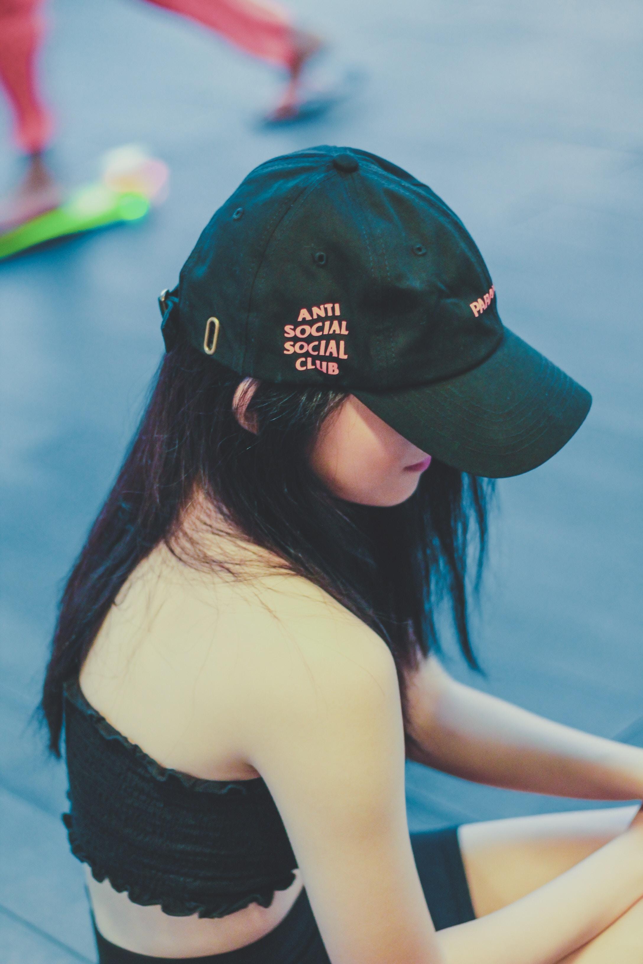 woman wearing black cap under sunny sky