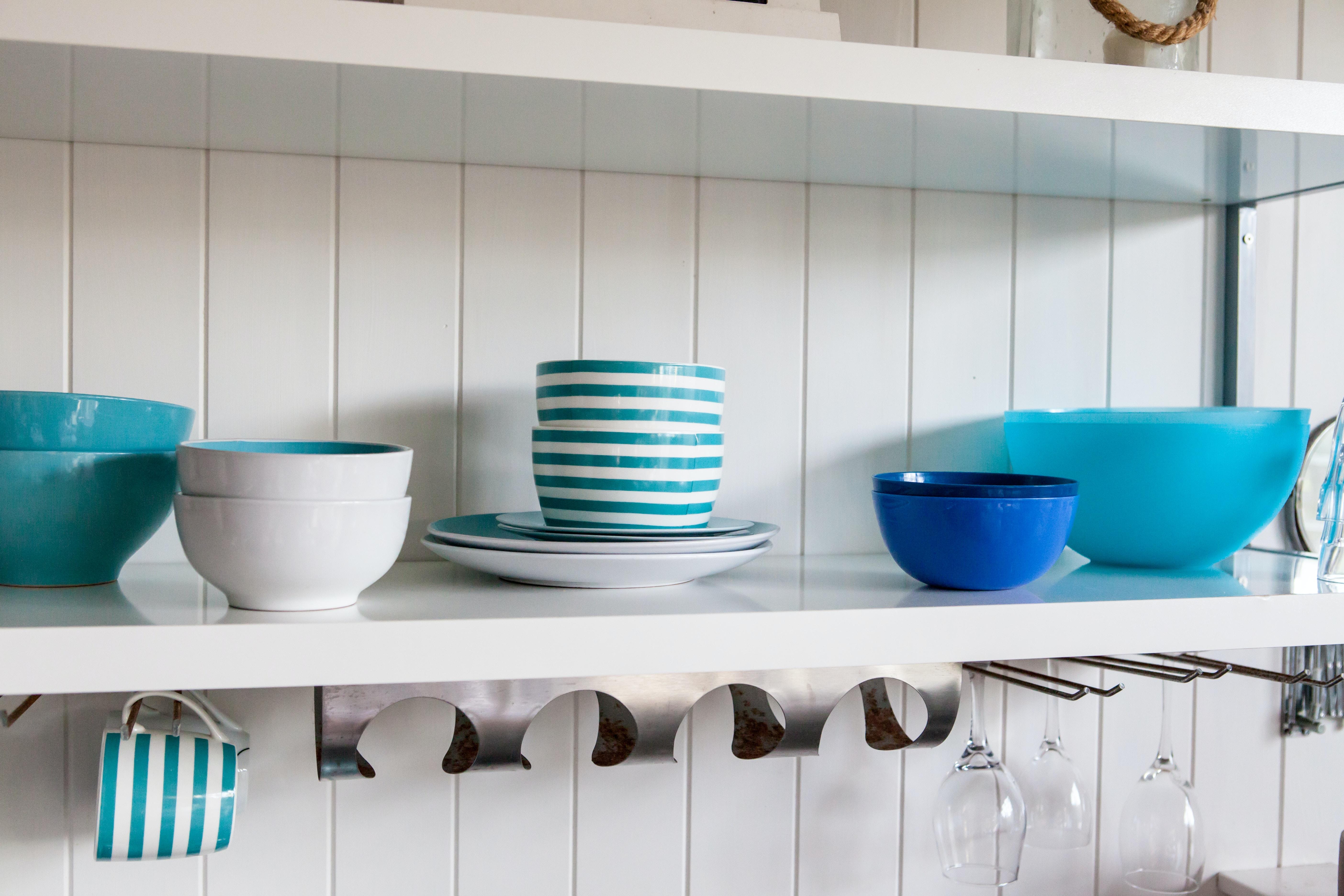 assorted ceramic food bowls on white shelf