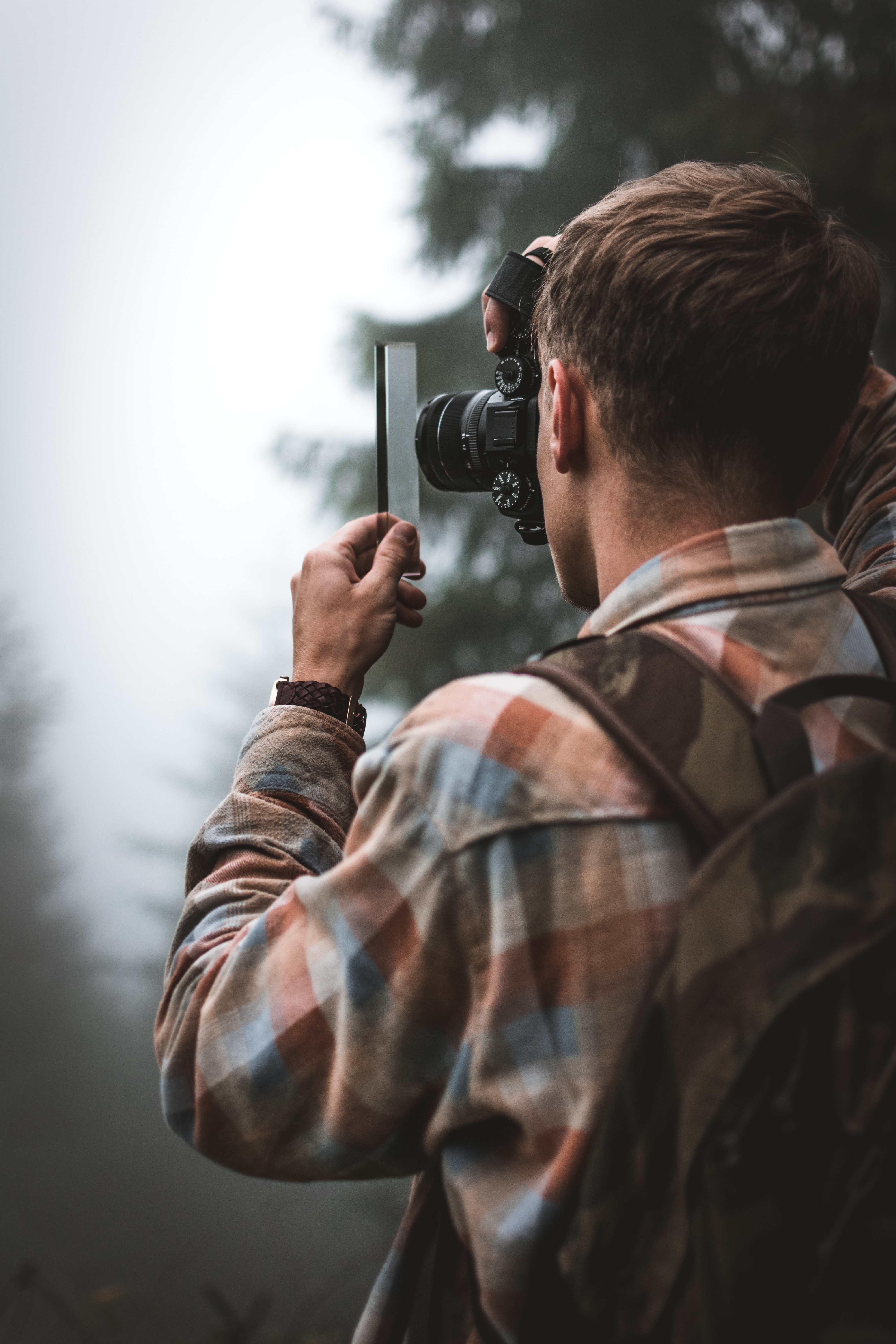 man taking photography outdoors