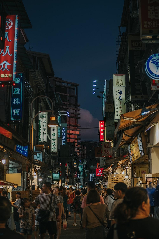 people walking along alley road