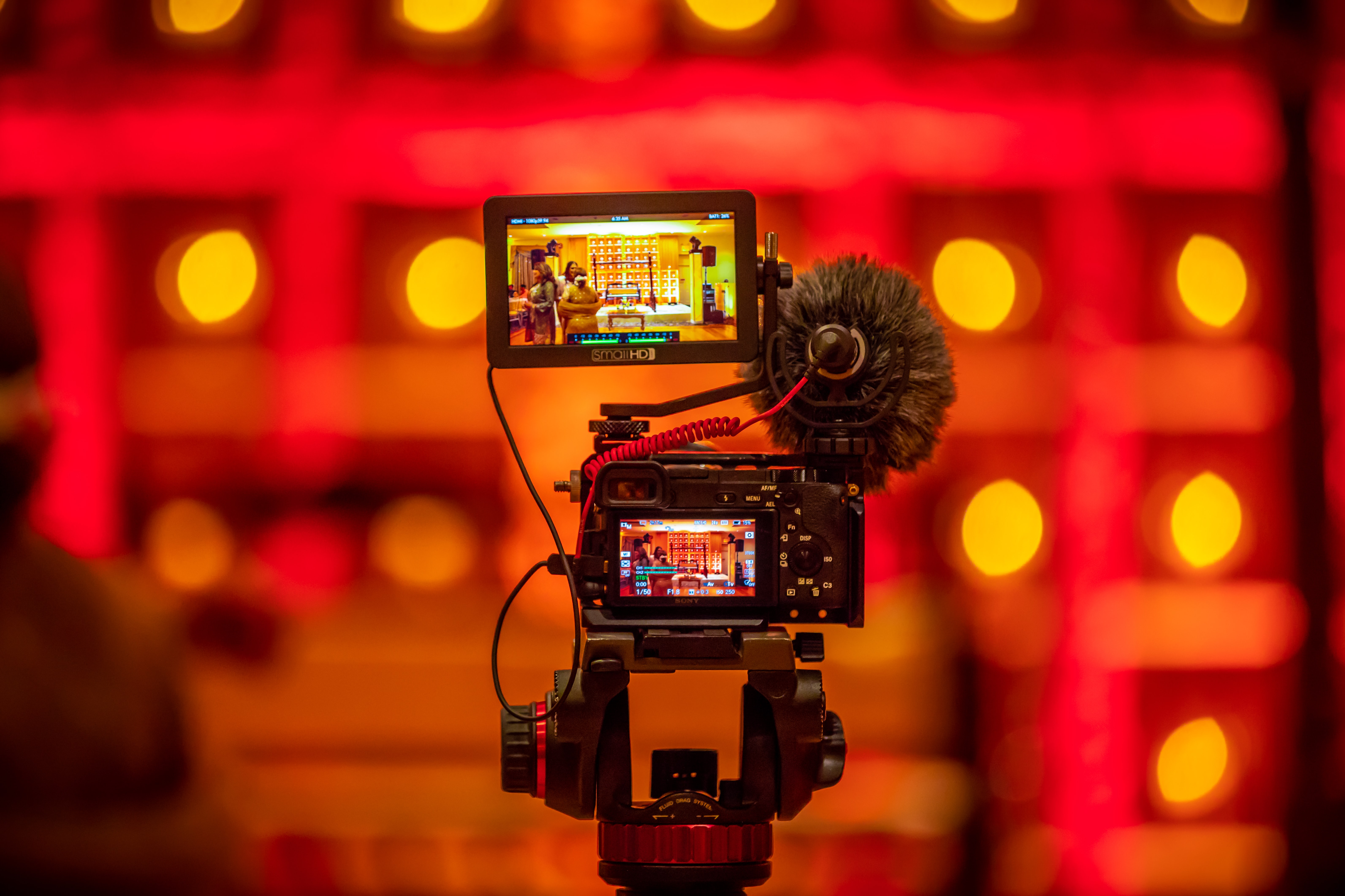 selective focus photography of black camera taking video