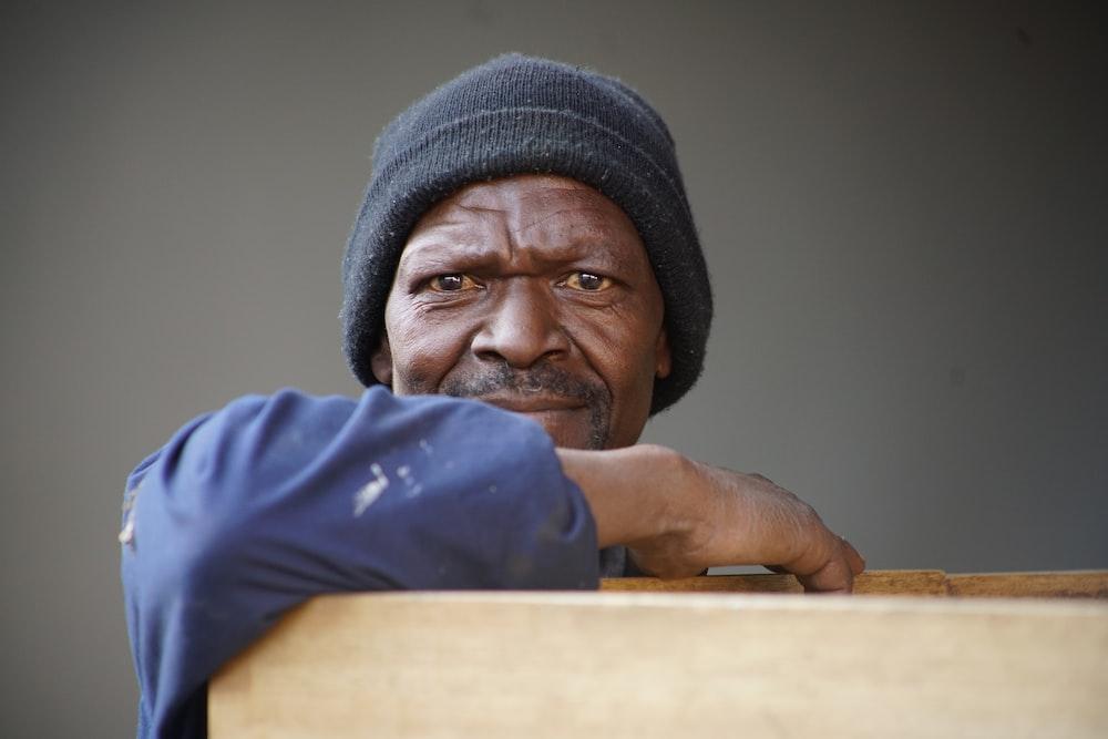 man wearing black knit cap
