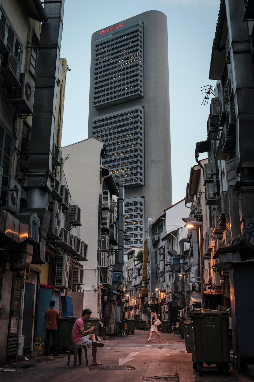 gray and black concrete buildings under blue sky