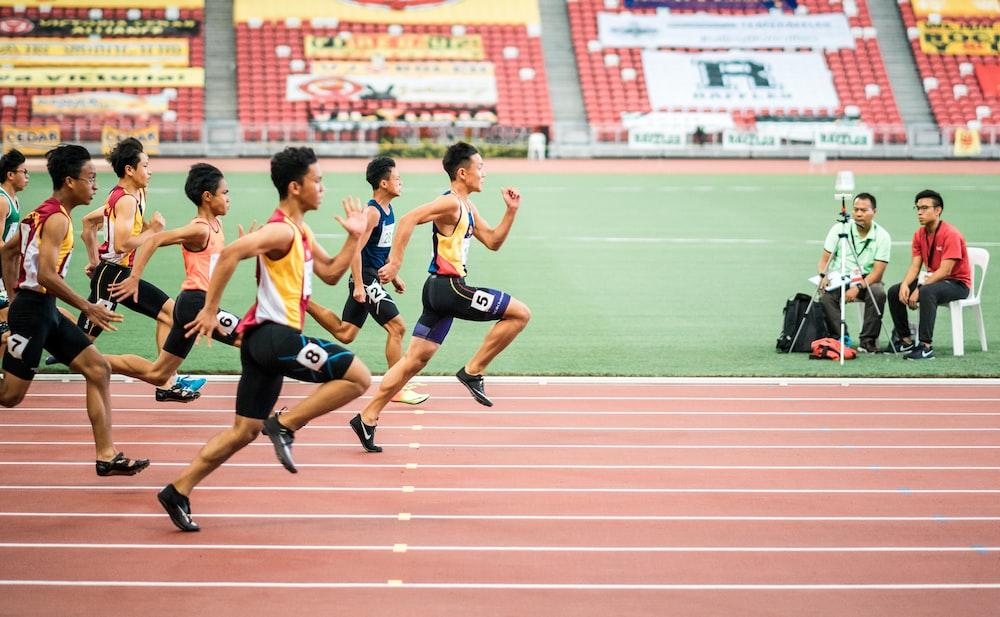 group of men running in track field