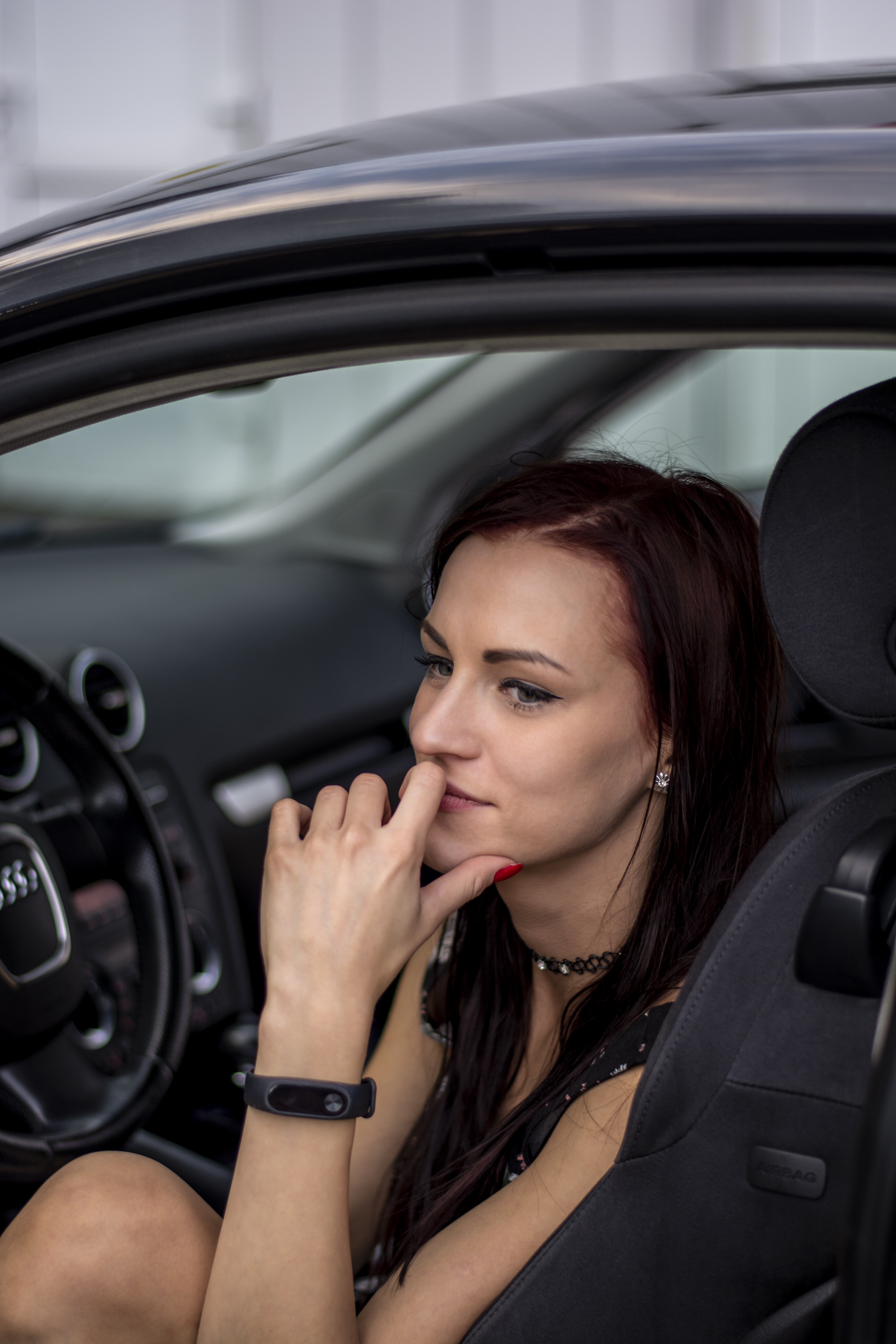 selective focus photo of woman sitting front of vehicle steering wheel