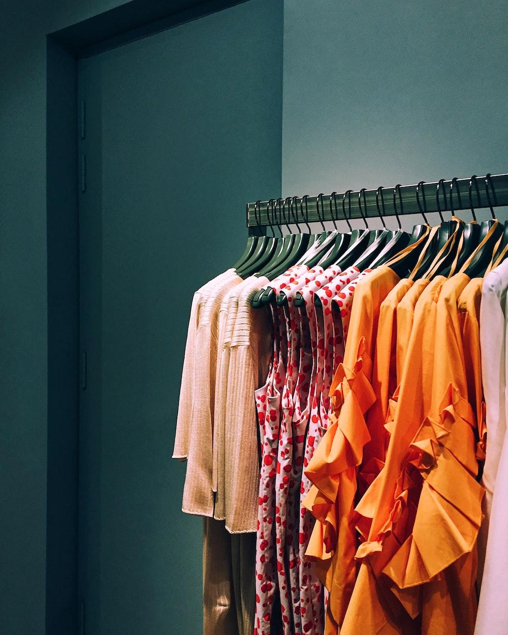 assorted-color shirt lot hang on rack