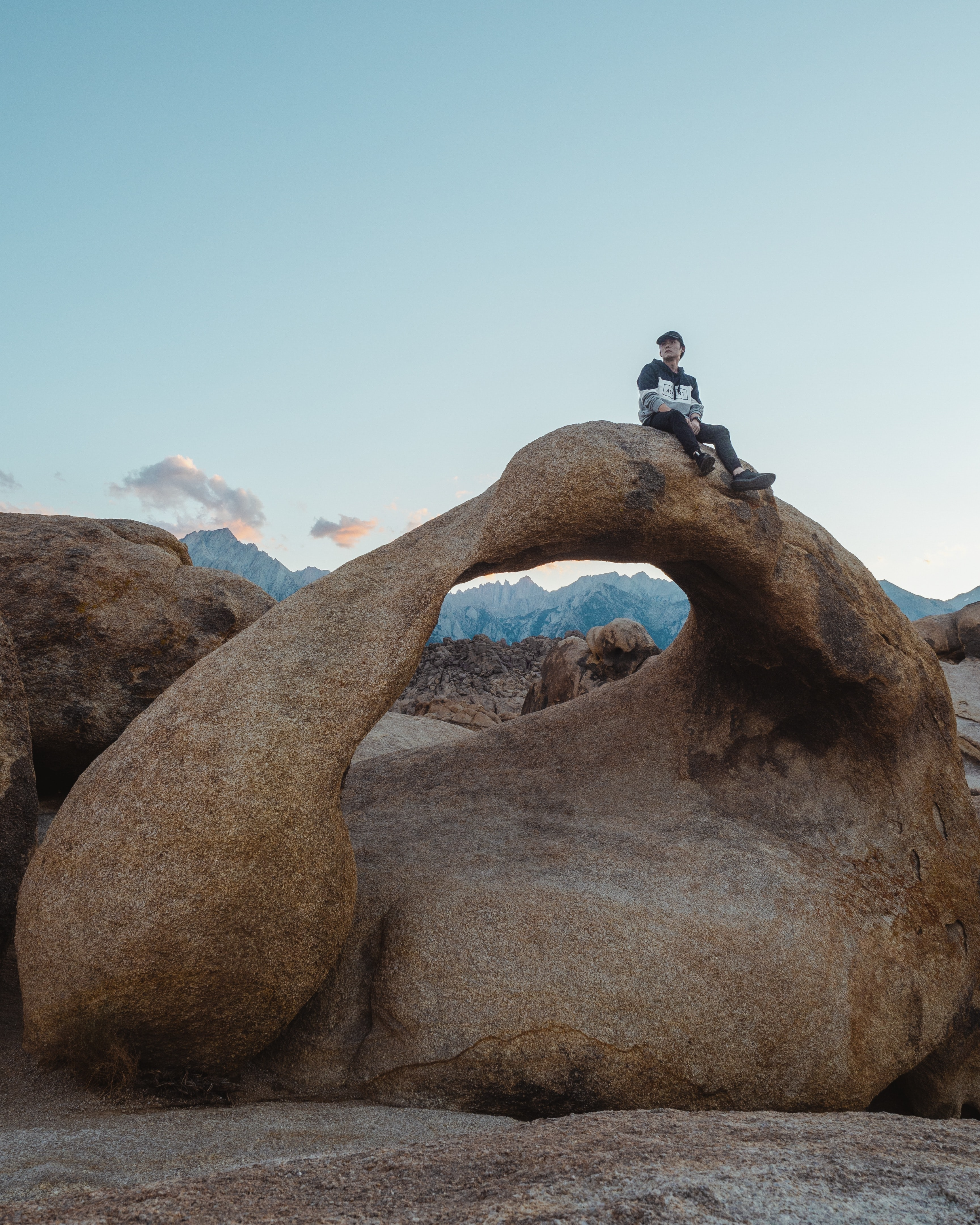 man sitting on rock structure
