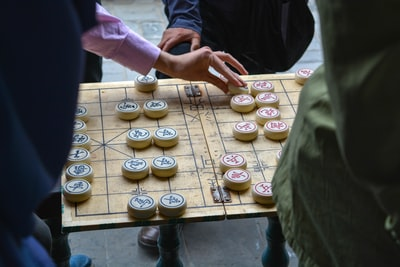 person playing board game
