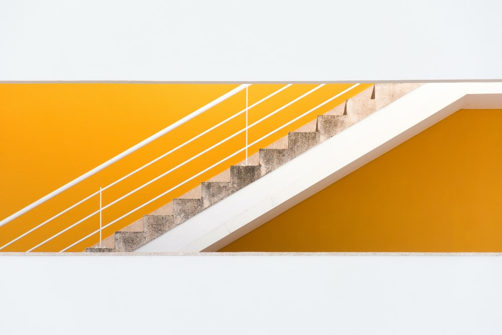 white and gray stairs with hand railings