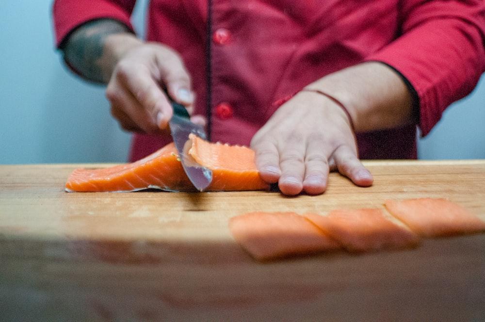 person slicing salmon