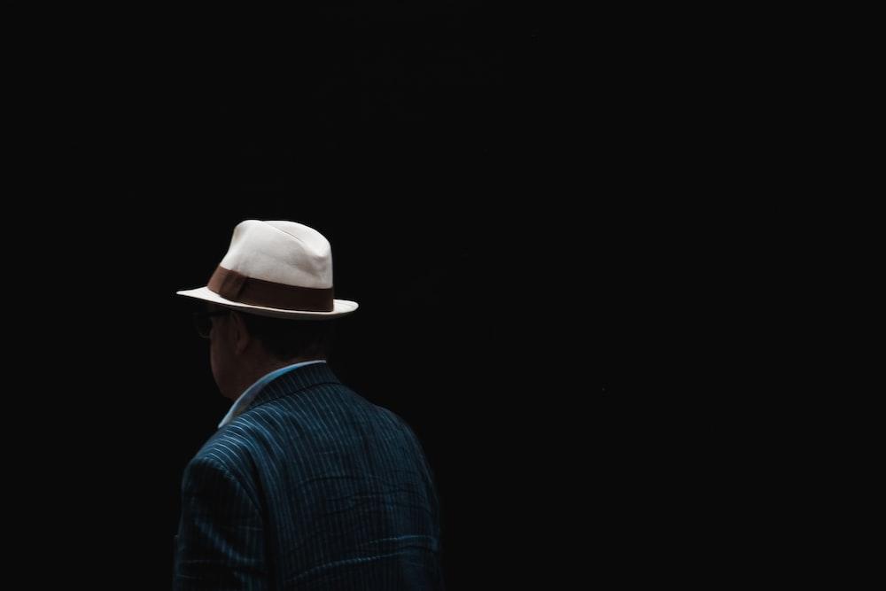 man wearing white fedora hat