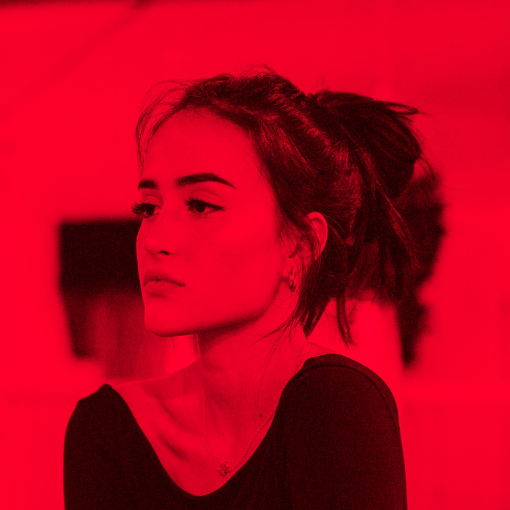 portrait photograph of woman in black shirt